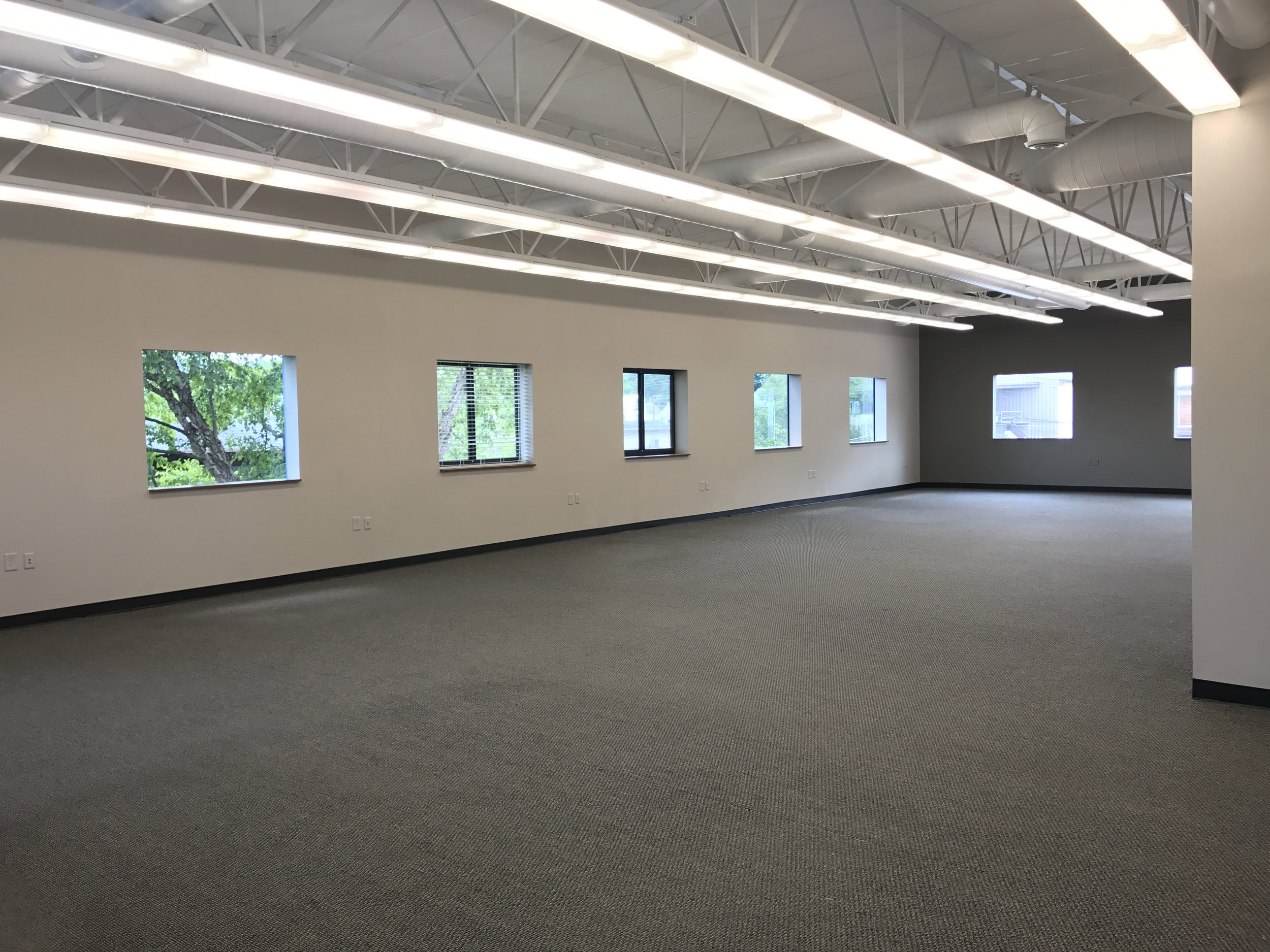 This open corner office offers lots of natural lighting and a great view of Lunken Airport!