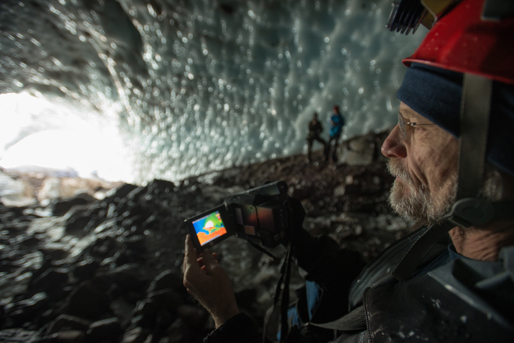 Dr. Andreas Pflitsch uses a thermal imaging camera to identify hot spots in the glacier caves. Here, he's showing how it works by pointing it to the cave entrance and showing the color differences between hot (white to red) and cool (blue).