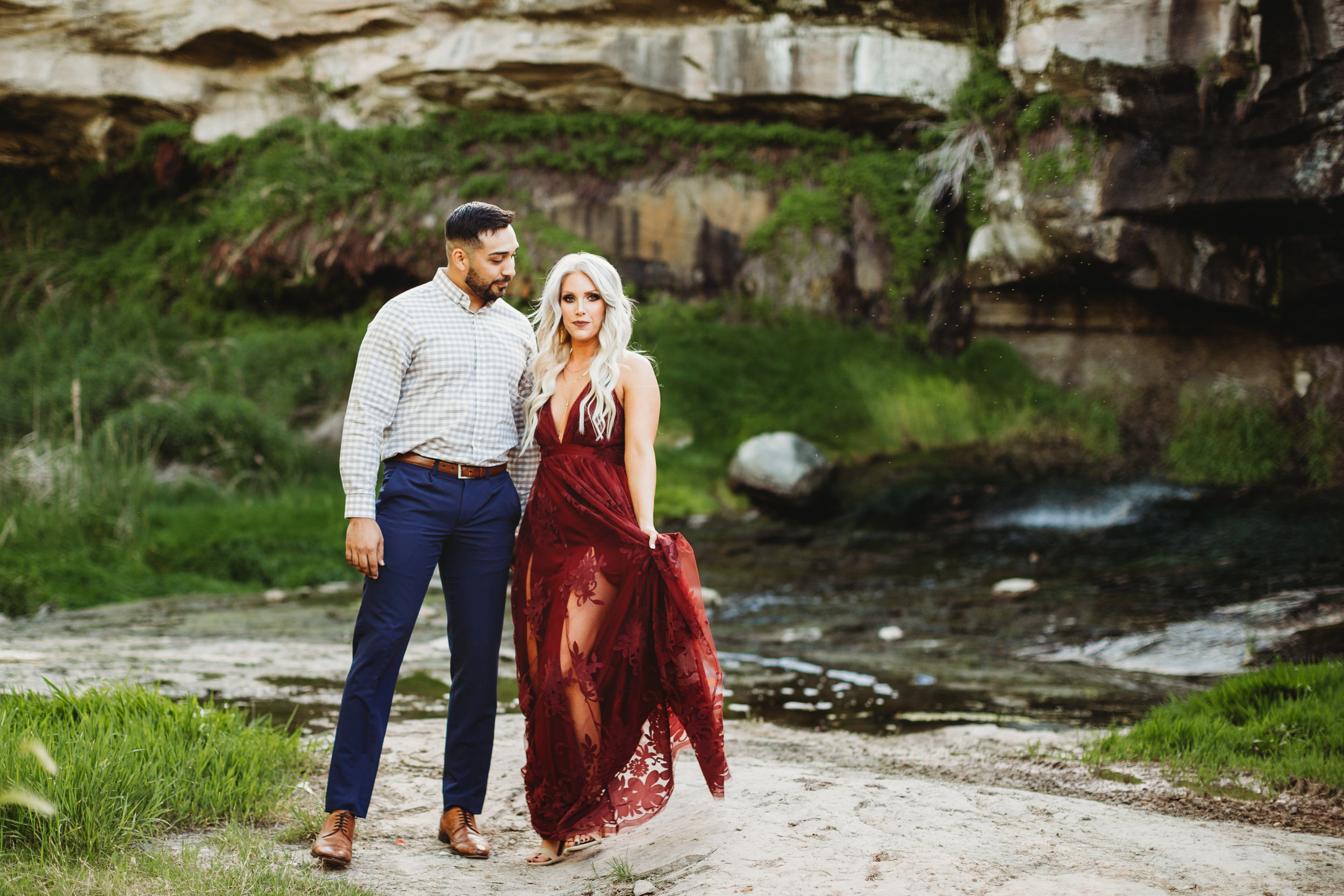 Formal engagement photographs of engaged couple in front of wildlife refuge full of green foliage arm in arm #engagementphotos #riverfalls #engaged #personality #amarillotexas #engagementphotographer #lifestylephotos #amarillophotographer #locationchoice #texasengagementphotos #engagment #tealawardphotography #wildliferefuge