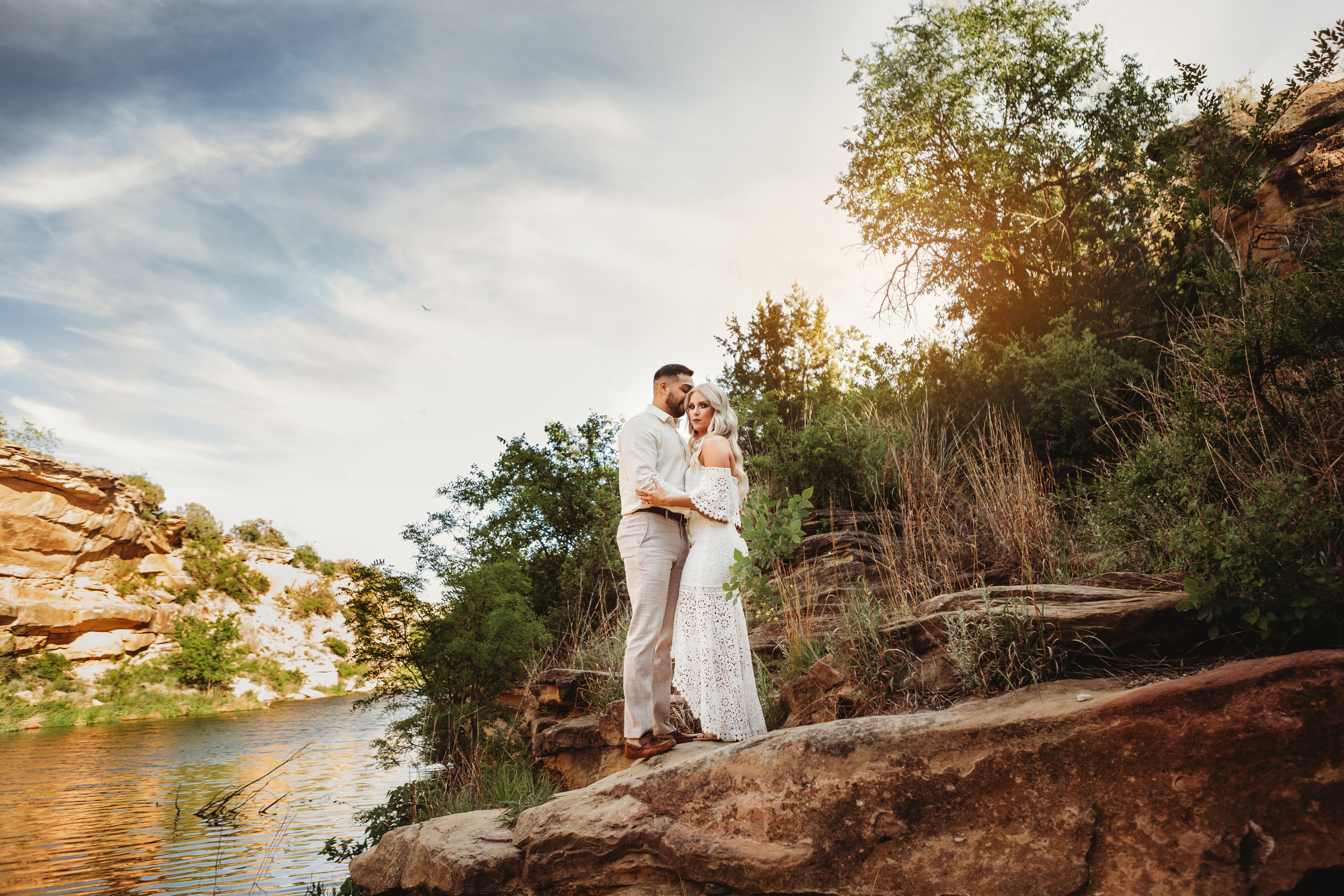 Standing on the river bank in casual white and neutral colored casual clothing #engagementphotos #riverfalls #engaged #personality #amarillotexas #engagementphotographer #lifestylephotos #amarillophotographer #locationchoice #texasengagementphotos #engagment #tealawardphotography #wildliferefuge
