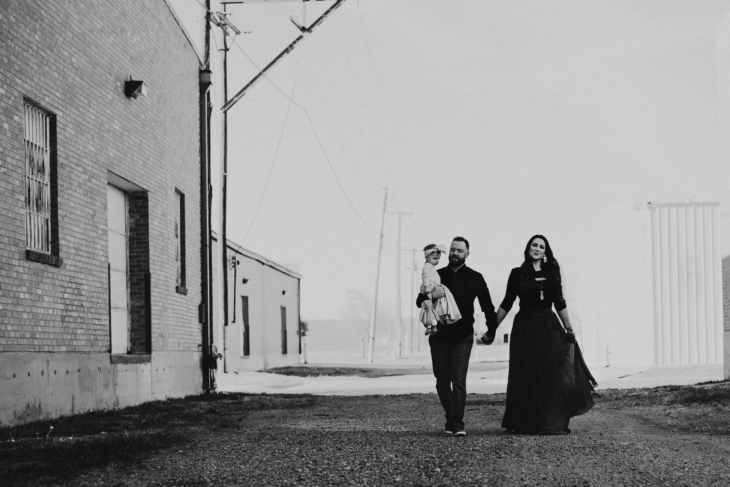 Walking hand in hand down downtown Amarillo black and white #rubyred #familyphotos #downtown #hairstyle #personality #amarillotexas #familyphotographer #lifestylephotos #amarillophotographer #locationchoice #texasfamilyphotos #familyofthree