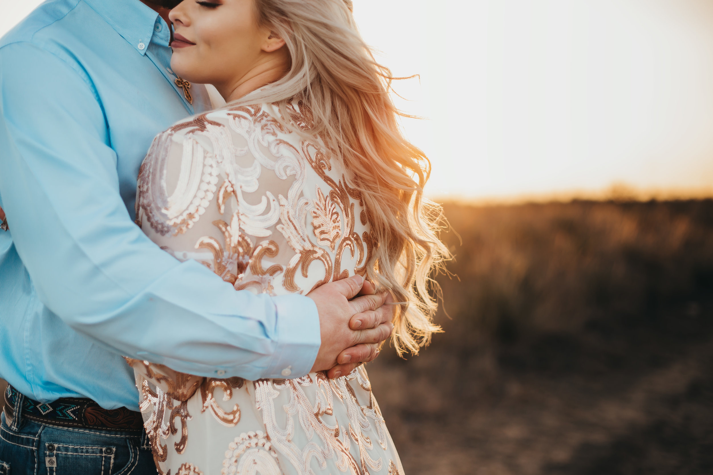 Zoomed in photo accenting the lighting and wardrobe including a blue pearl snap collared shirt and sequin jacket #engagementphotos #engaged #personality #amarillotexas #engagementphotographer #lifestylephotos #amarillophotographer #locationchoice #texasengagementphotos #engagment #tealawardphotography #westernstyle