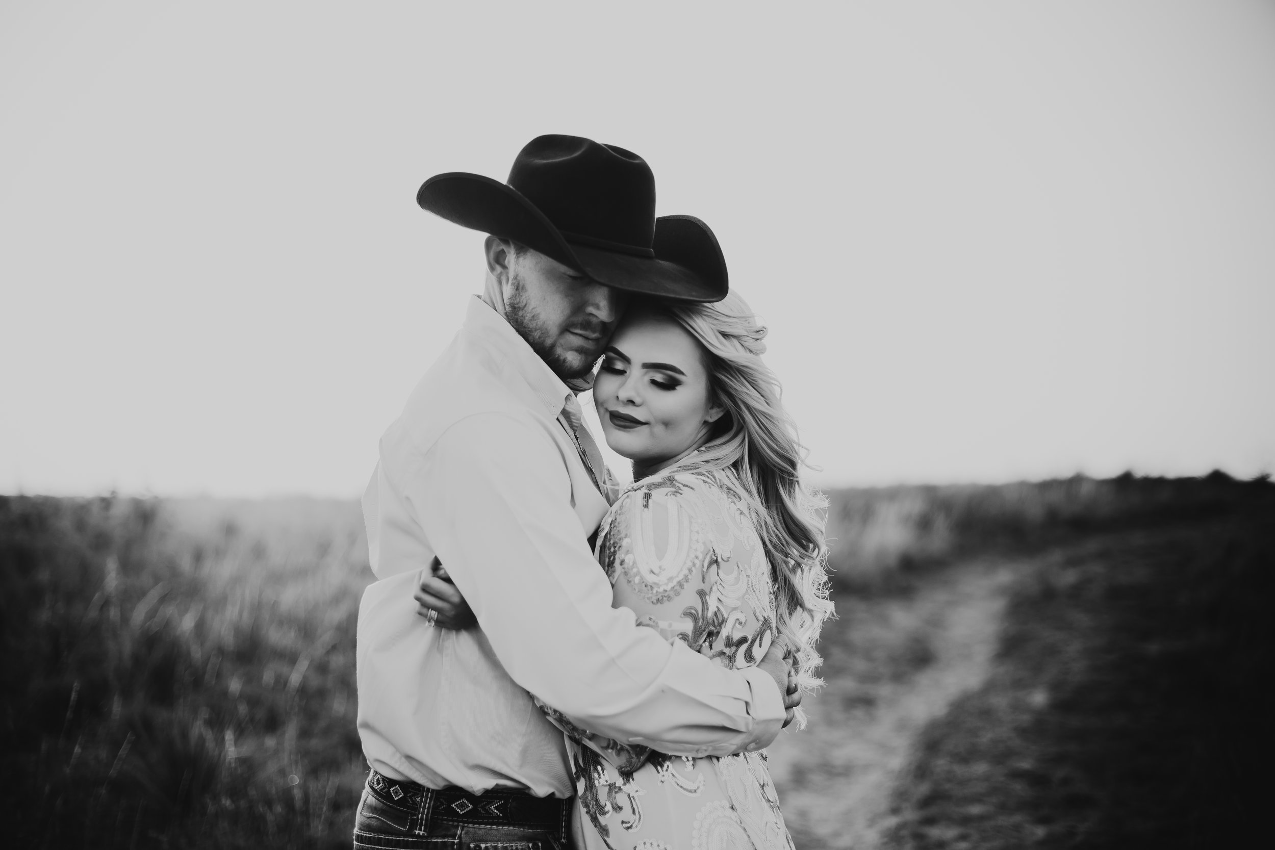 Black and white photo of engaged couple sharing an intimate embrace #engagementphotos #engaged #personality #amarillotexas #engagementphotographer #lifestylephotos #amarillophotographer #locationchoice #texasengagementphotos #engagment #tealawardphotography #westernstyle