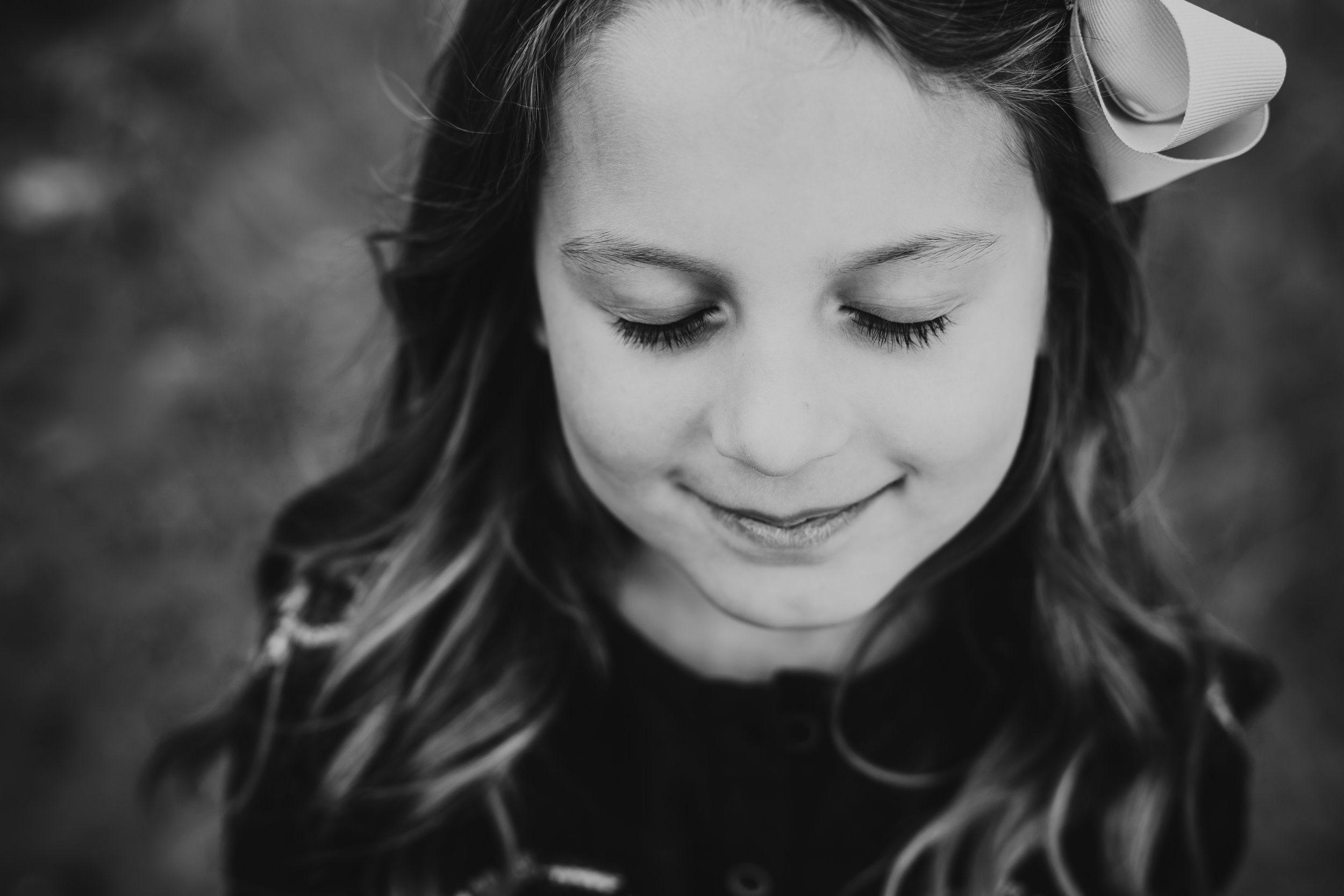 Close up feature picture of big sister during family session in black and white #tealawardphotography #texasfamilyphotographer #amarillophotographer #amarillofamilyphotographer #lifestylephotography #emotionalphotography #familyphotosoot #family #lovingsiblings #purejoy #familyphotos #familyphotographer #greatoutdoors