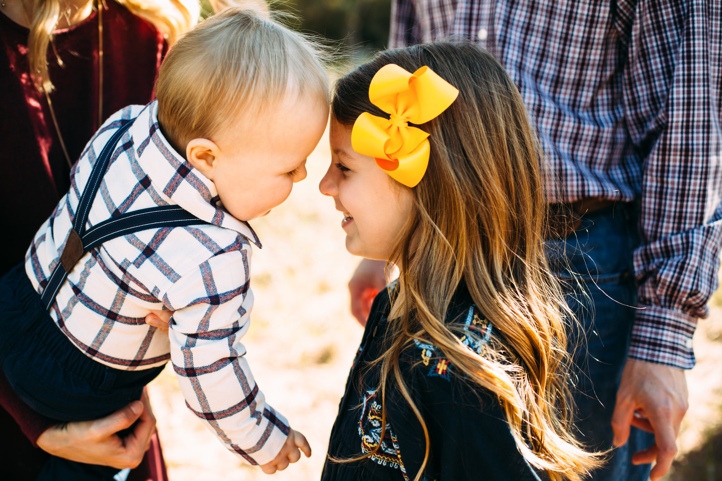 Forehead to forehead these cute kids show their love for each other and accent their yellow bow and suspenders #tealawardphotography #texasfamilyphotographer #amarillophotographer #amarillofamilyphotographer #lifestylephotography #emotionalphotography #familyphotosoot #family #lovingsiblings #purejoy #familyphotos #familyphotographer #greatoutdoors