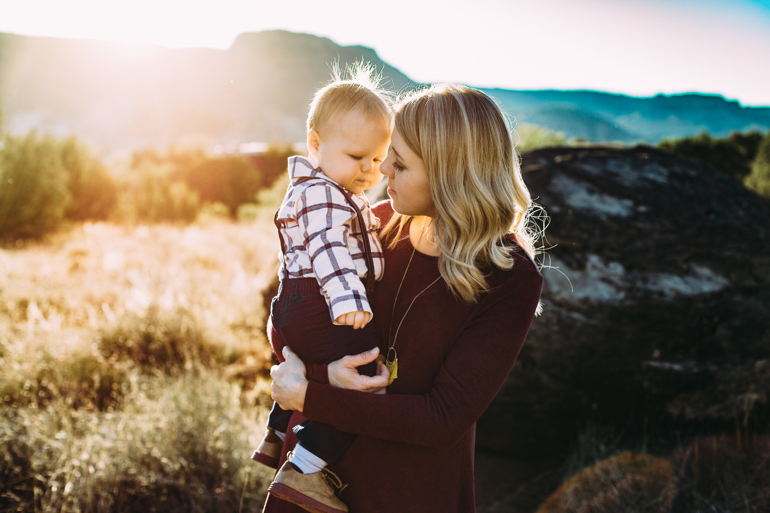 Mom snuggles baby boy at sunset #tealawardphotography #texasfamilyphotographer #amarillophotographer #amarillofamilyphotographer #lifestylephotography #emotionalphotography #familyphotosoot #family #lovingsiblings #purejoy #familyphotos #familyphotographer #greatoutdoors