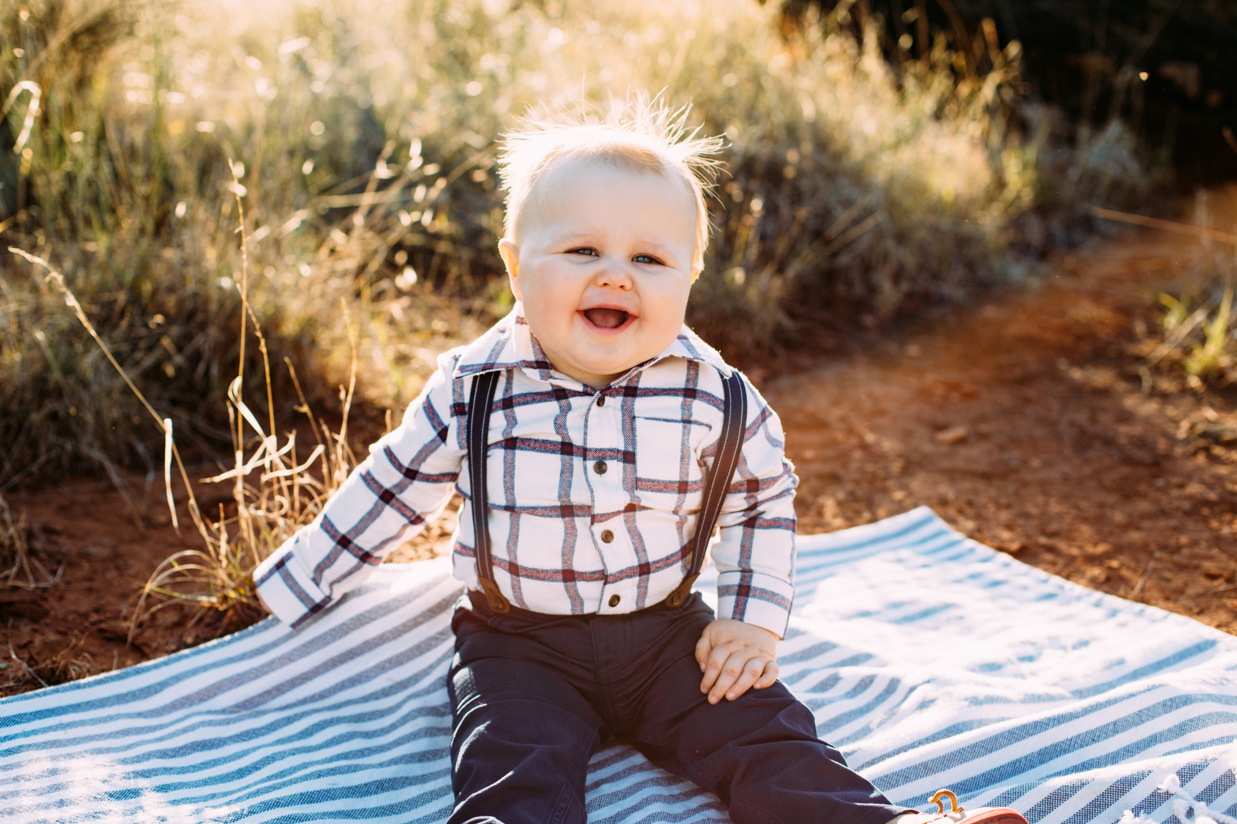 Big laughs and smiles from baby brother as he sits on picnic blanket #tealawardphotography #texasfamilyphotographer #amarillophotographer #amarillofamilyphotographer #lifestylephotography #emotionalphotography #familyphotosoot #family #lovingsiblings #purejoy #familyphotos #familyphotographer #greatoutdoors