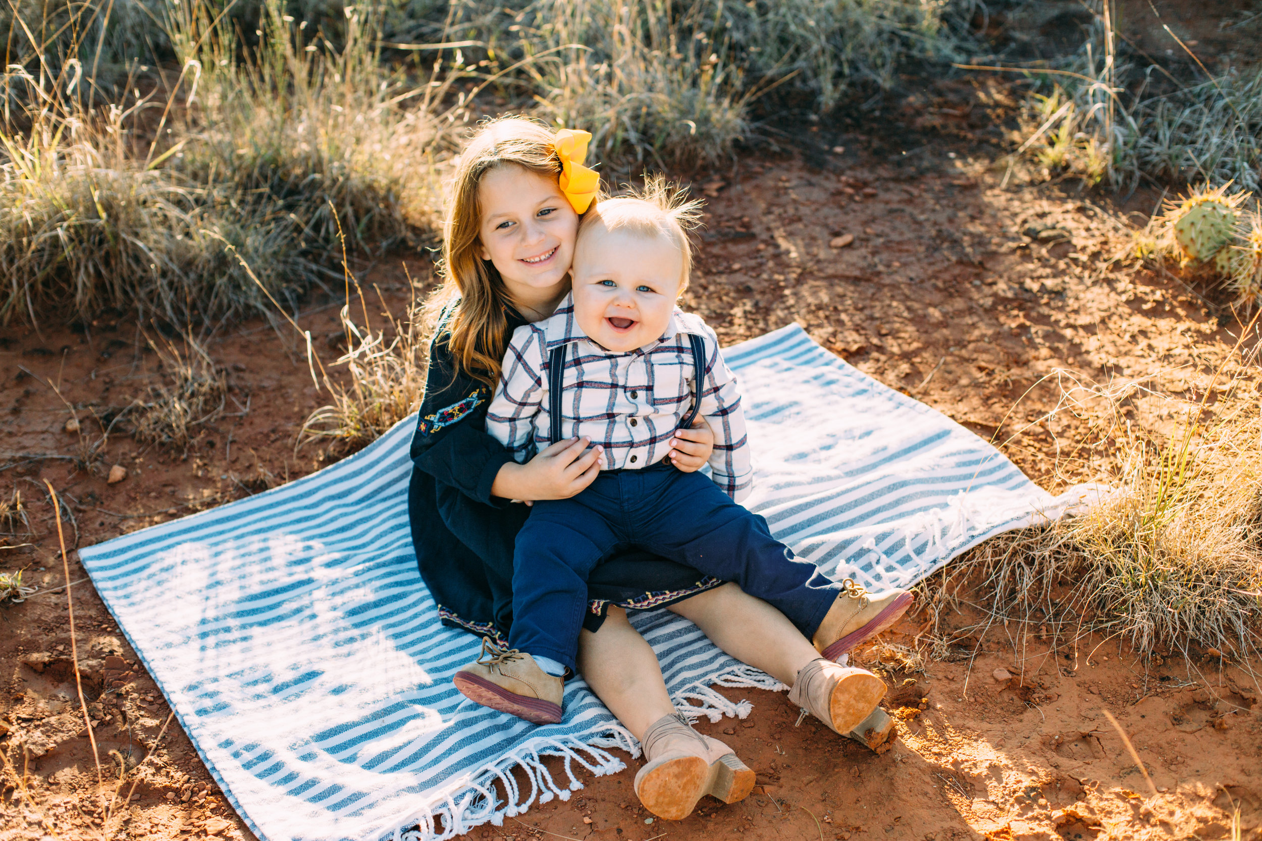 Brother and sister sit on picnic blanket while sister holds brother #tealawardphotography #texasfamilyphotographer #amarillophotographer #amarillofamilyphotographer #lifestylephotography #emotionalphotography #familyphotosoot #family #lovingsiblings #purejoy #familyphotos #familyphotographer #greatoutdoors
