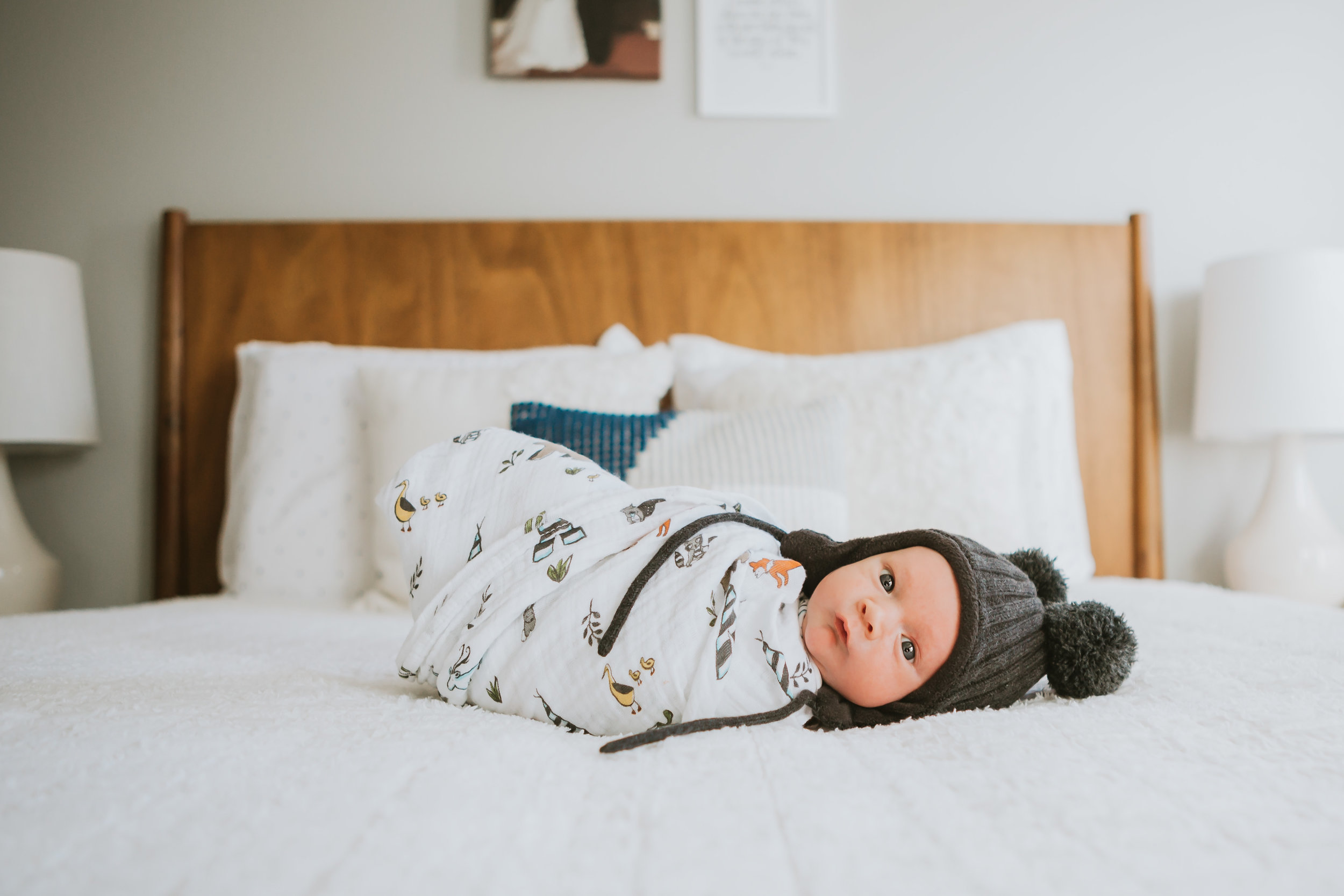 Little one laying on the bed swaddled and warm in a cute hat #tealawardphotography #texasnewbornphotographysession #amarillophotographer #amarilloenewbornphotographer #emotionalphotography #lifestylephotography #inhomesession #lifestyles #newbaby #newfamilyofthree #sweetbaby #nurseryphotos