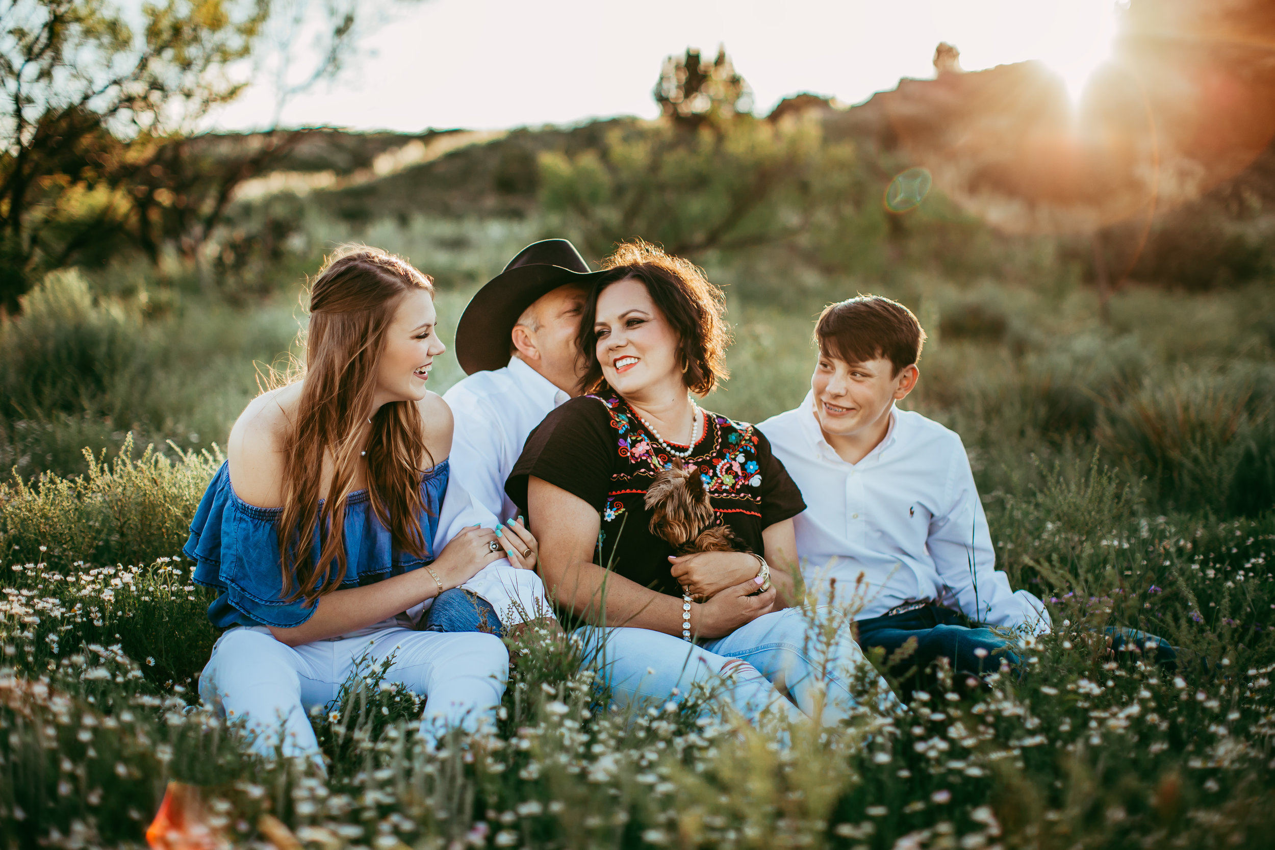 Family sitting together for family photo session on family ranch #tealawardphotography #texaslocationchoice #amarillophotographer #amarillofamilyphotographer #emotionalphotography #engagementphotography #couplesphotography #pickingaphotosessionlocation #whatsimportant #everythingtogether #pickingcolorsforphotos #location #photosessionlocation