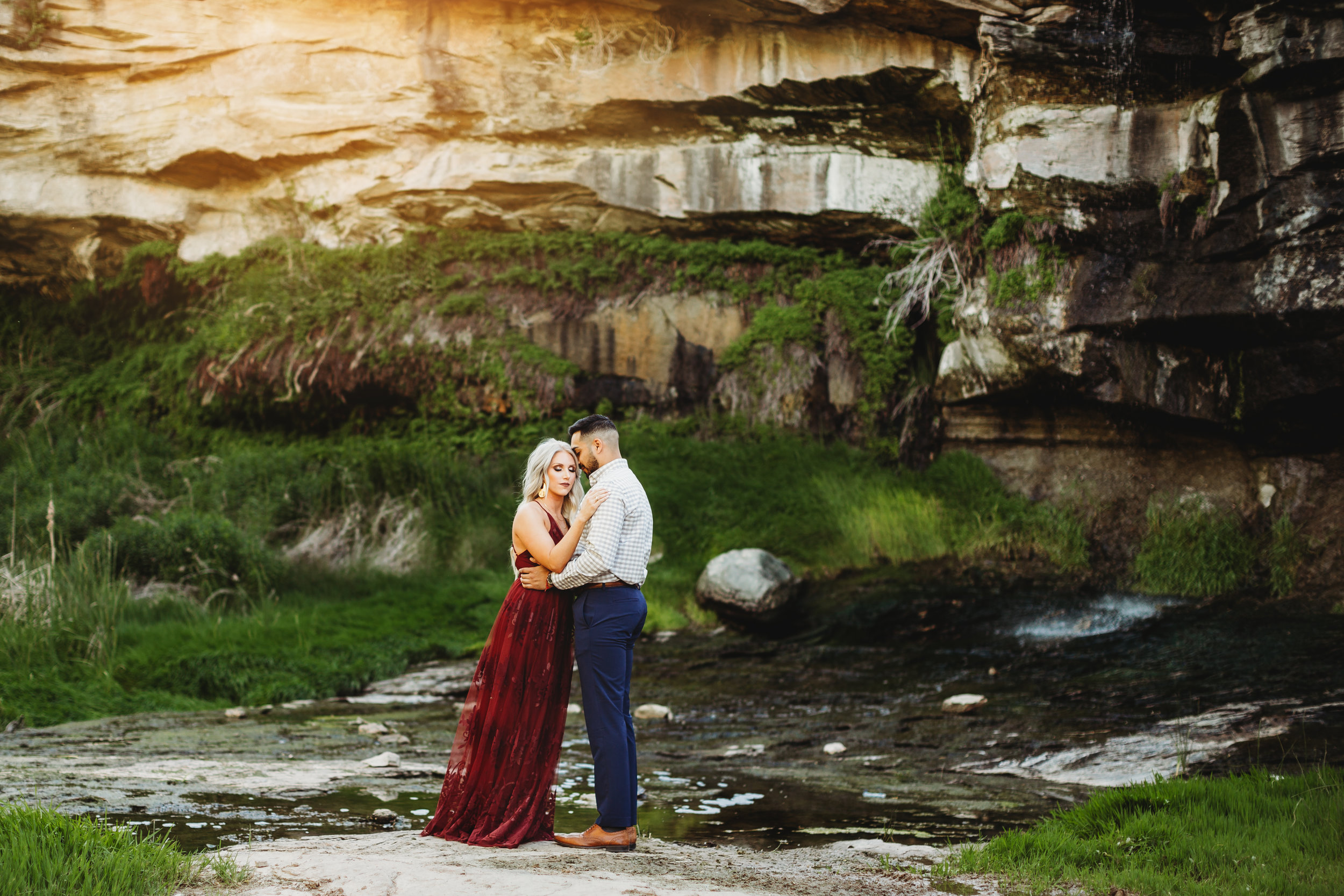 Wildlife refuge with greenery in gorge and engaged couple standing in the middle #tealawardphotography #texaslocationchoice #amarillophotographer #amarillofamilyphotographer #emotionalphotography #engagementphotography #couplesphotography #pickingaphotosessionlocation #whatsimportant #everythingtogether #pickingcolorsforphotos #location #photosessionlocation