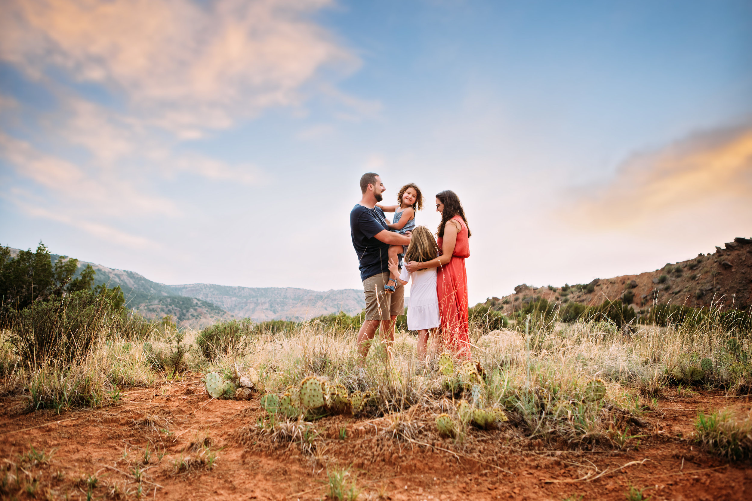 Summer photography session with family in front of red rocks and natural landscape #tealawardphotography #texassummerphotographer #pictureseason #amarillophotographer #amarillofamilyphotographer #emotionalphotography #engagementphotography #couplesphotography #pickingaseasonforphotosessions #whatsimportant #everythingtogether #pickingcolorsforphotos #summerphotos #greeneryinphotos