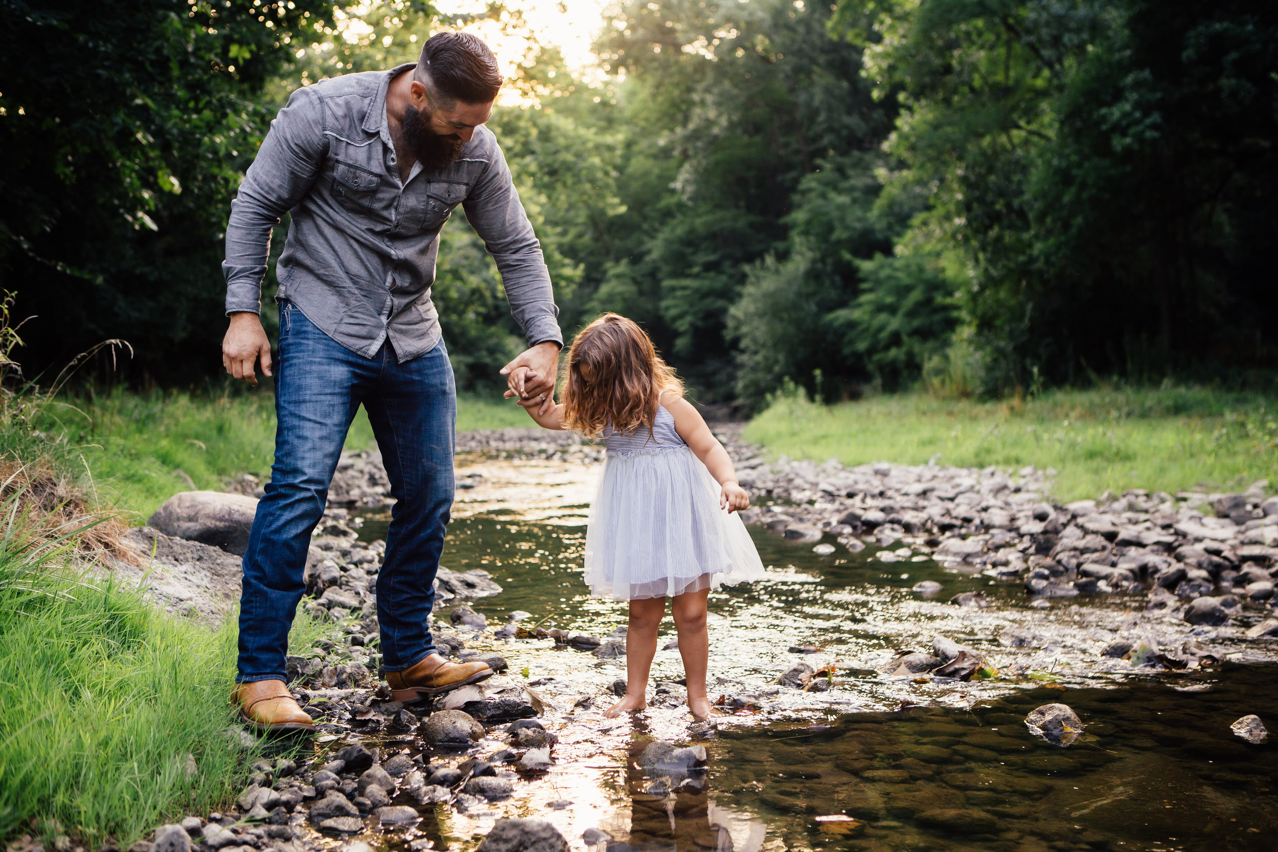 Dad and daughter get close to the creek as they play together during family photos in the summer #tealawardphotography #texassummerphotographer #pictureseason #amarillophotographer #amarillofamilyphotographer #emotionalphotography #engagementphotography #couplesphotography #pickingaseasonforphotosessions #whatsimportant #everythingtogether #pickingcolorsforphotos #summerphotos #greeneryinphotos