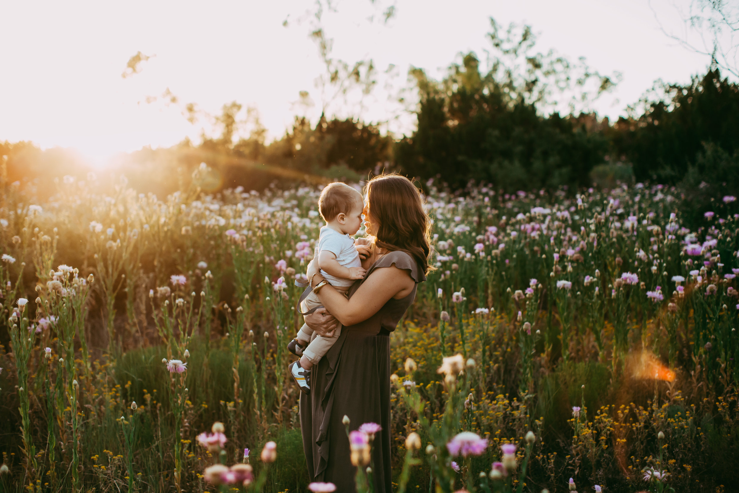 Wild flowers and gorgeous sunset with mom and baby boy surrounded by flowers #tealawardphotography #texassummerphotographer #pictureseason #amarillophotographer #amarillofamilyphotographer #emotionalphotography #engagementphotography #couplesphotography #pickingaseasonforphotosessions #whatsimportant #everythingtogether #pickingcolorsforphotos #summerphotos #greeneryinphotos