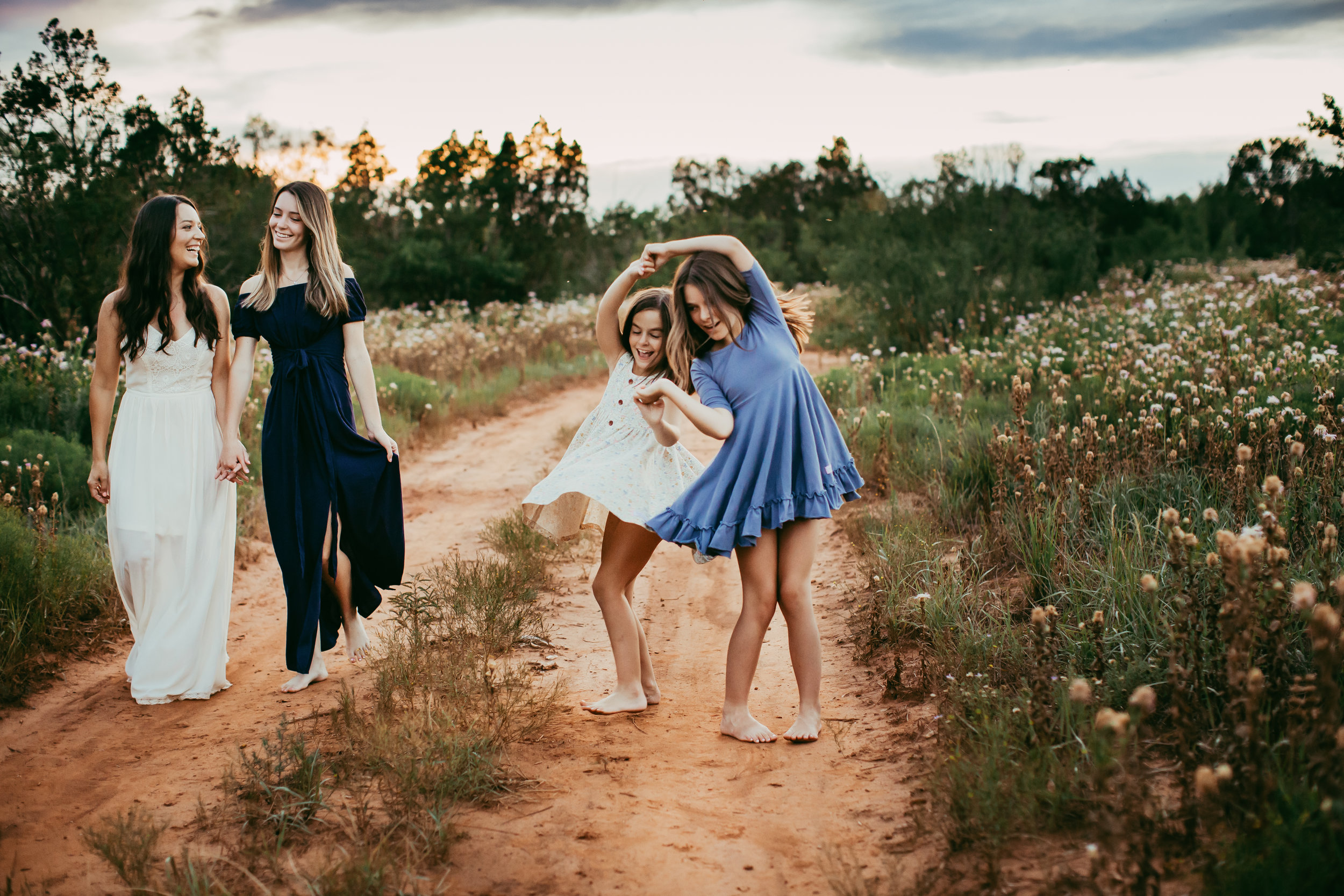 Dancing together down this dirt path between beautiful fields of wildflowers #tealawardphotography #texassummerphotographer #pictureseason #amarillophotographer #amarillofamilyphotographer #emotionalphotography #engagementphotography #couplesphotography #pickingaseasonforphotosessions #whatsimportant #everythingtogether #pickingcolorsforphotos #summerphotos #greeneryinphotos