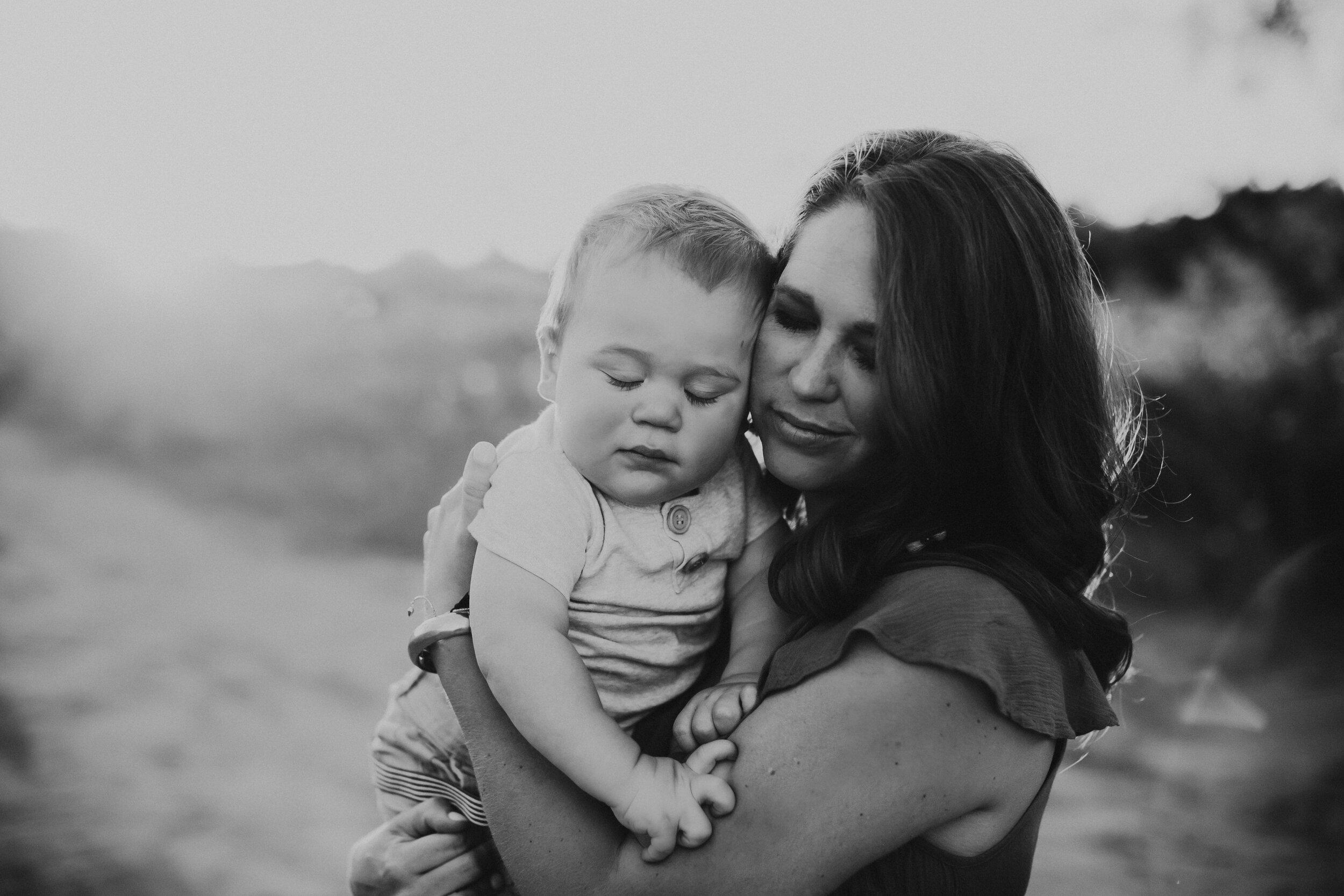 Black and white tender moment between mom and child #tealawardphotography #texasfamilyphotographer #amarillophotographer #amarillofamilyphotographer #lifestylephotography #emotionalphotography #familyphotoshoot #family #lovingsiblings #purejoy #familyphotos #naturalfamilyinteraction