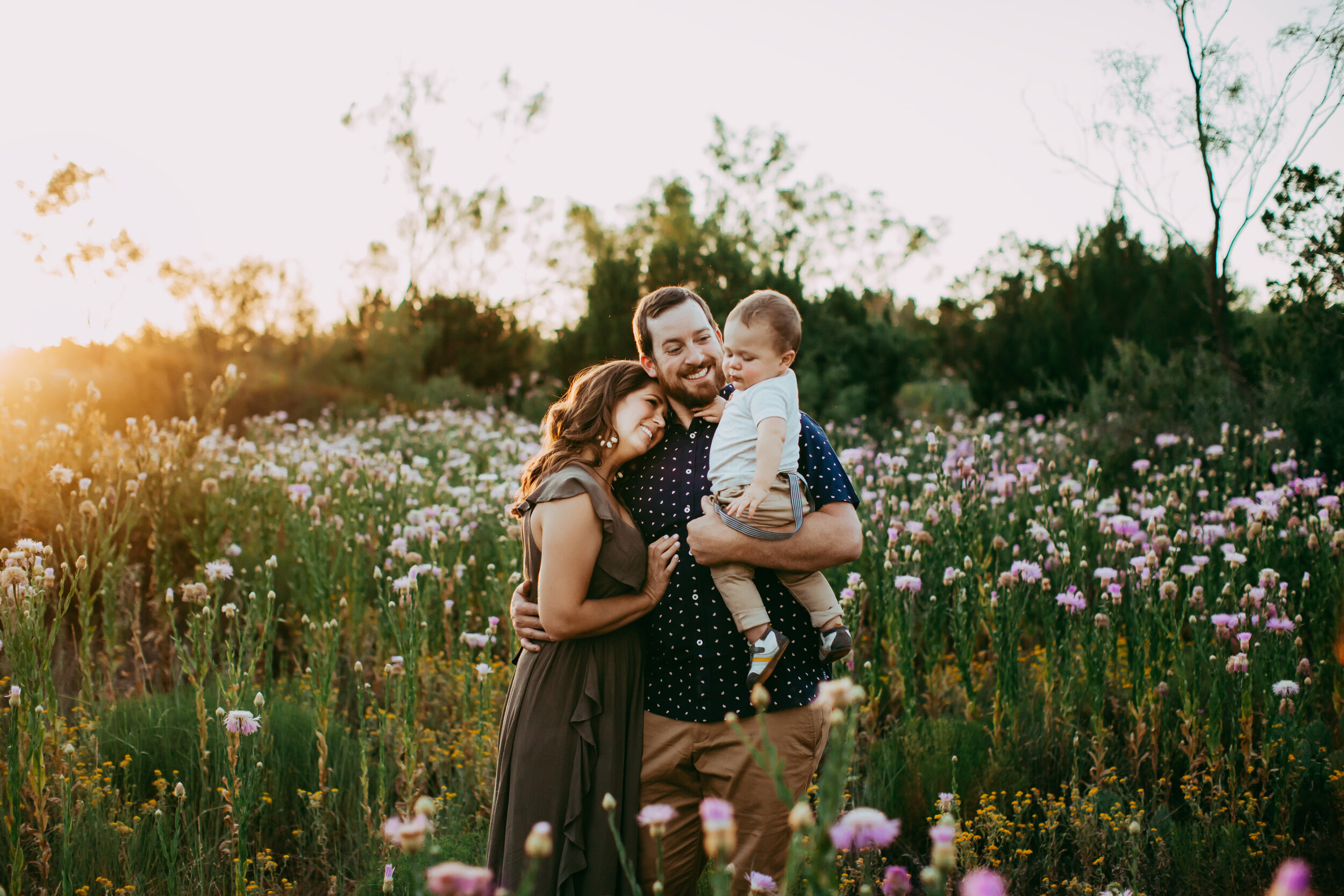 Tender hug between this family of three in the middle of this wildflower field at sunset #tealawardphotography #texasfamilyphotographer #amarillophotographer #amarillofamilyphotographer #lifestylephotography #emotionalphotography #familyphotoshoot #family #lovingsiblings #purejoy #familyphotos #naturalfamilyinteraction