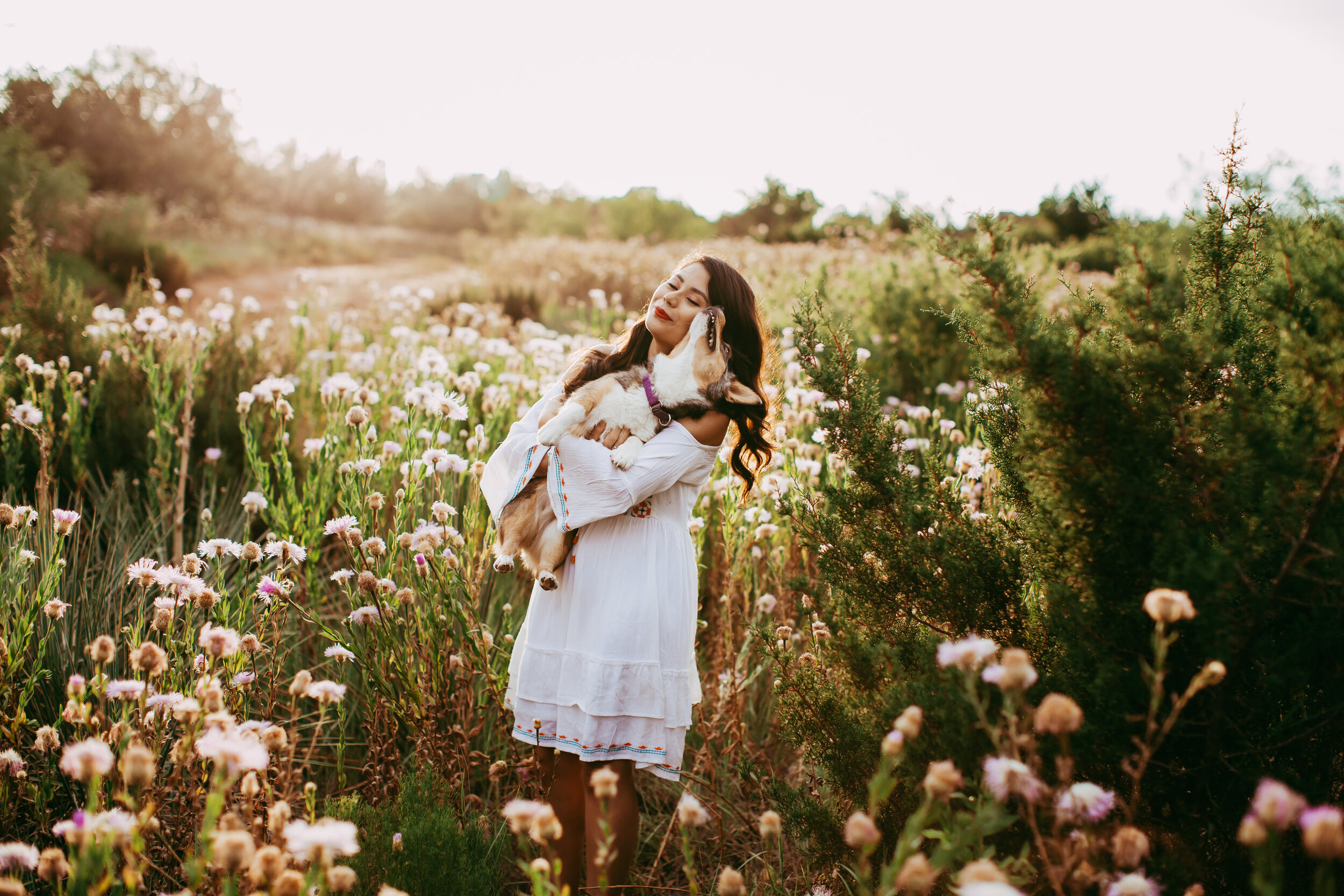 Holding puppy in a field of wildflowers. There's nothing better! #tealawardphotography #texasphotographer #amarillophotography #amarillophotographer #lifestylephotography #emotionalphotography #photoshoot #family #puppylove #purejoy #puppyphotos #lifestyleinteraction