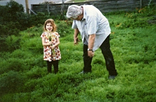 My Great-Grandfather and me picking wildflowers in his garden.  I may only be four years old here, but you can probably still find me today wearing a similar floral print dress surrounded by flowers!