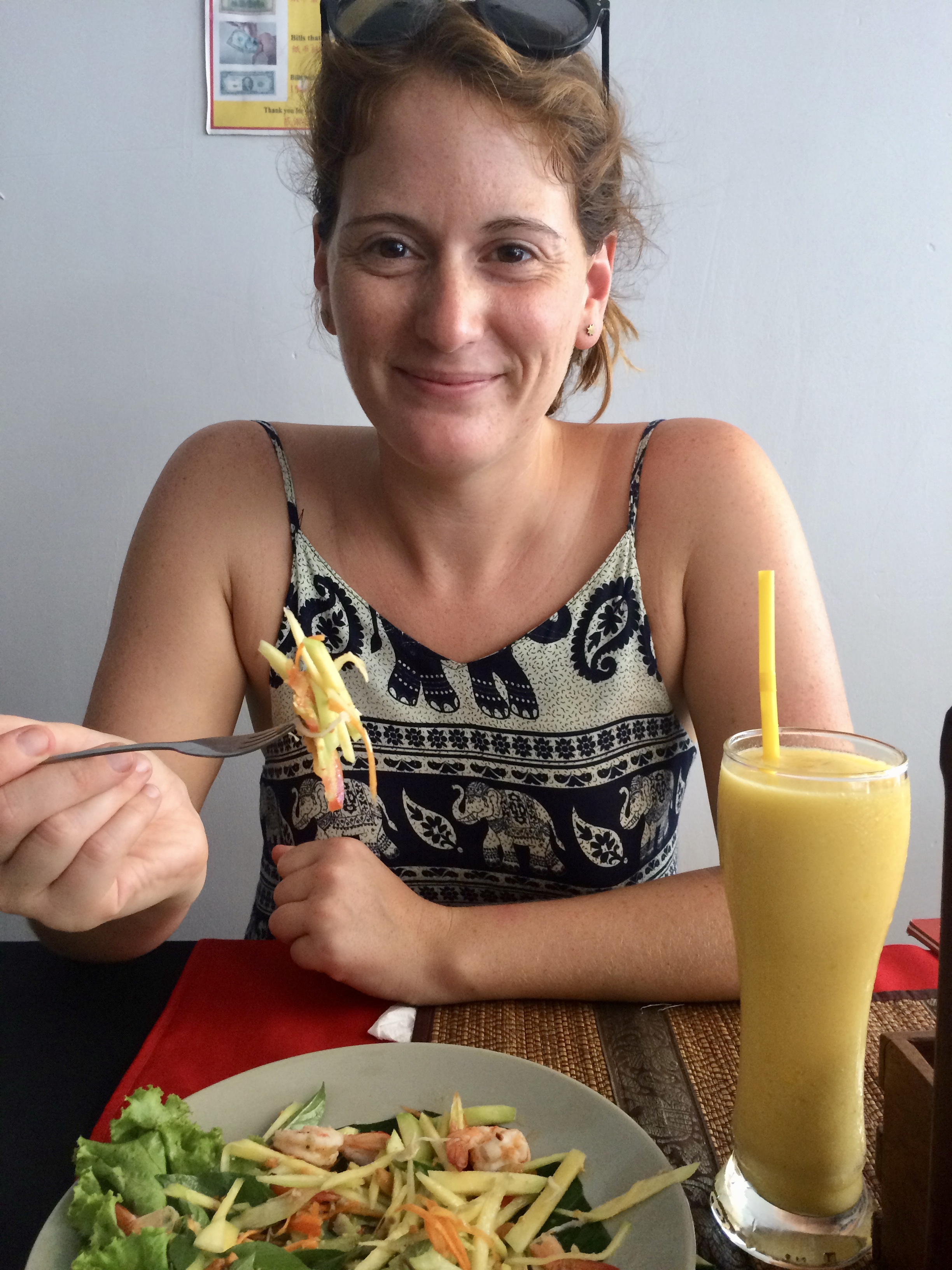 Lunch of fresh papaya salad and a mango smoothie in Siem Reap, Cambodia.