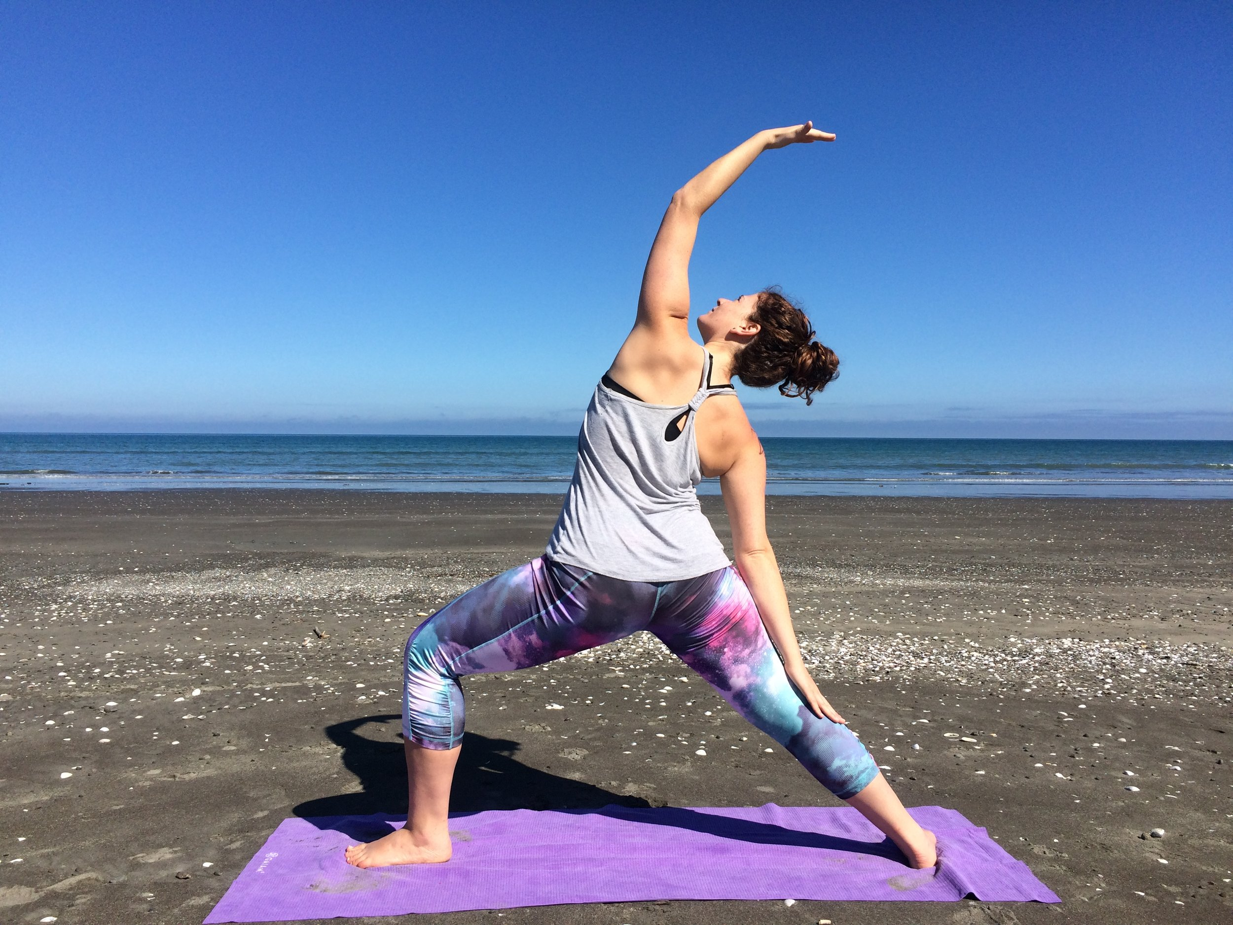 Breaking out the yoga mat at Otaki Beach for our final day on the North Island.