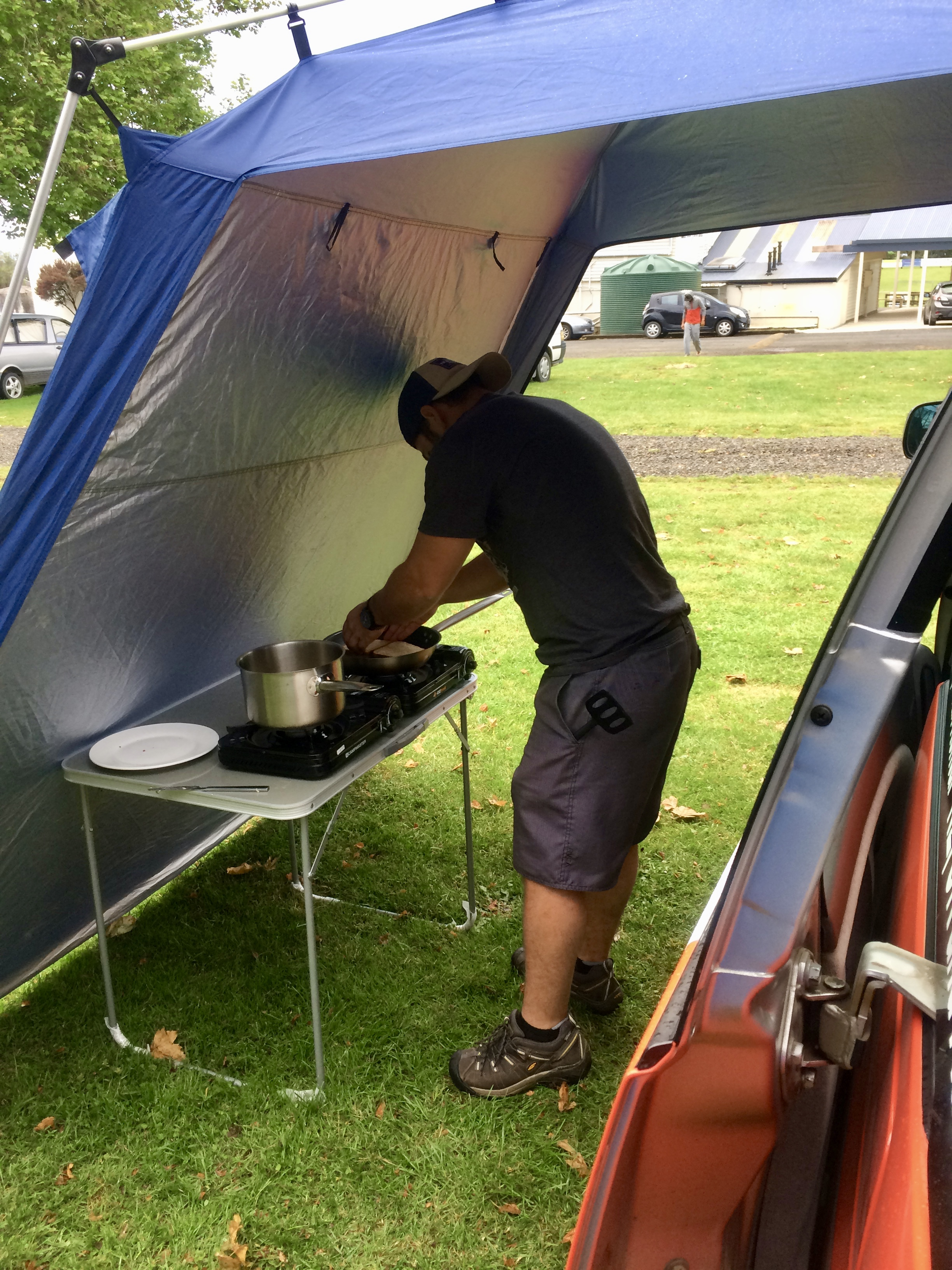 Our sweet awning set up with a little rain protection!