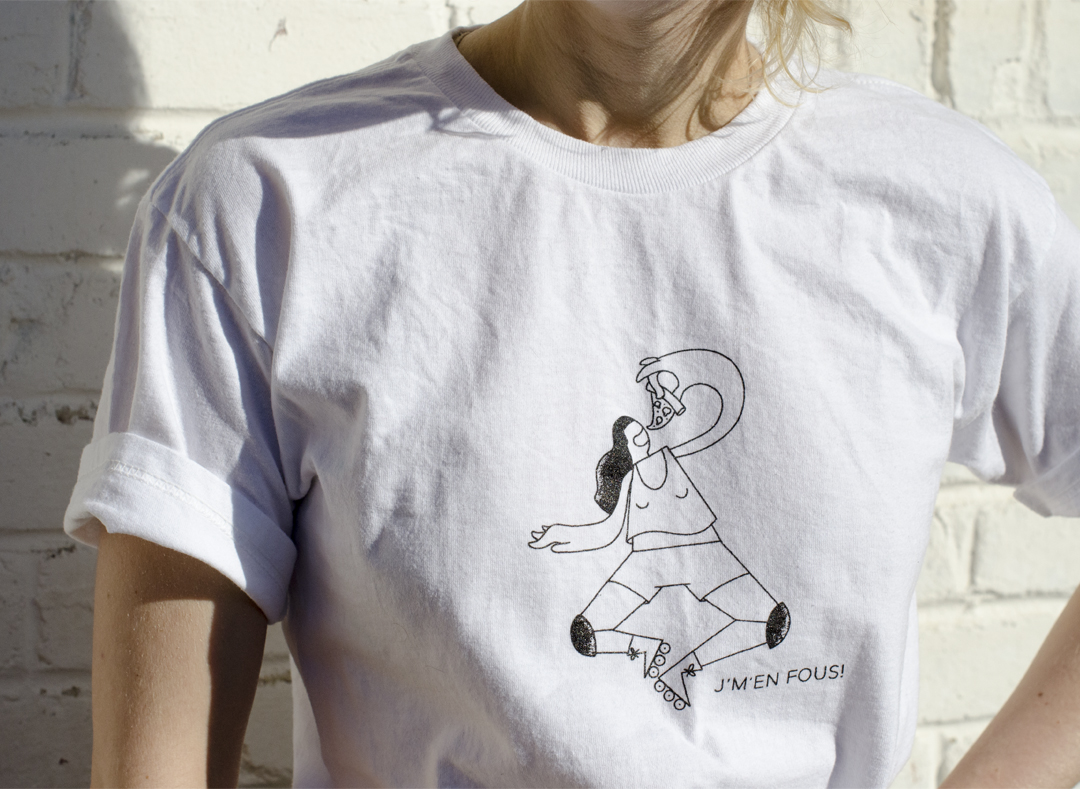 Woman wearing a tshirt with a character eating a slice of pizza