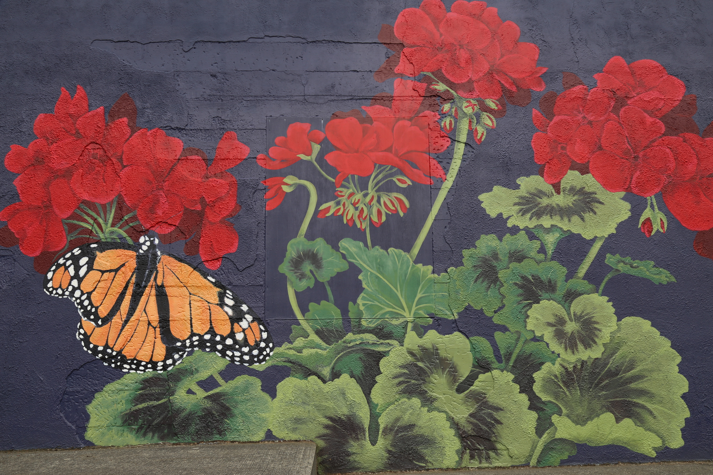 This pretty mural is painted on the side of the soda shop