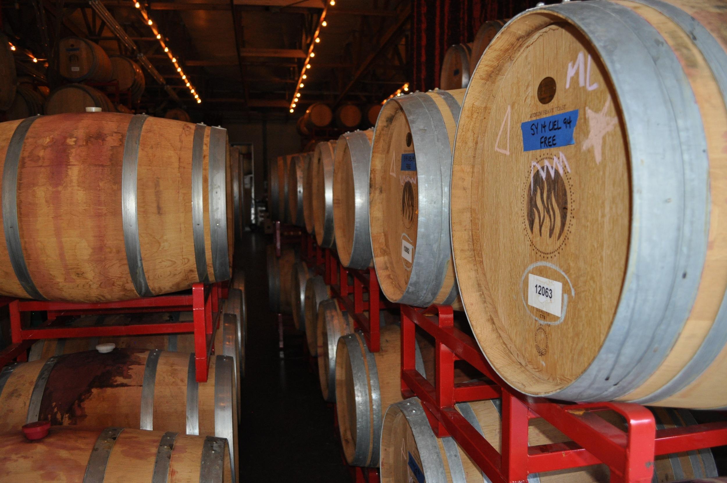 Aging wine in barrels.