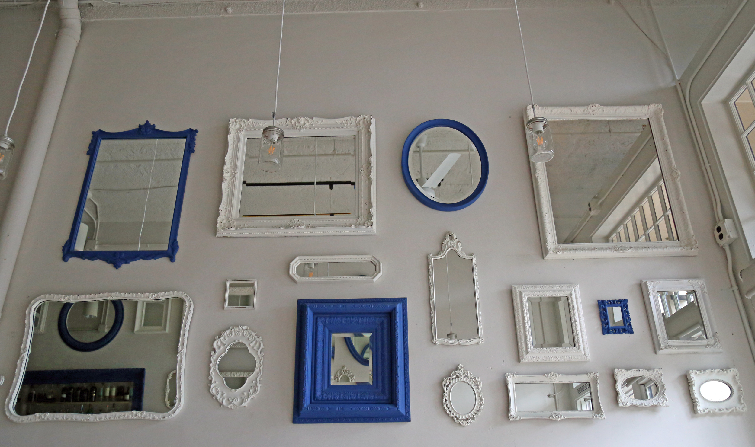 Painted mirrors decorate the white walls.