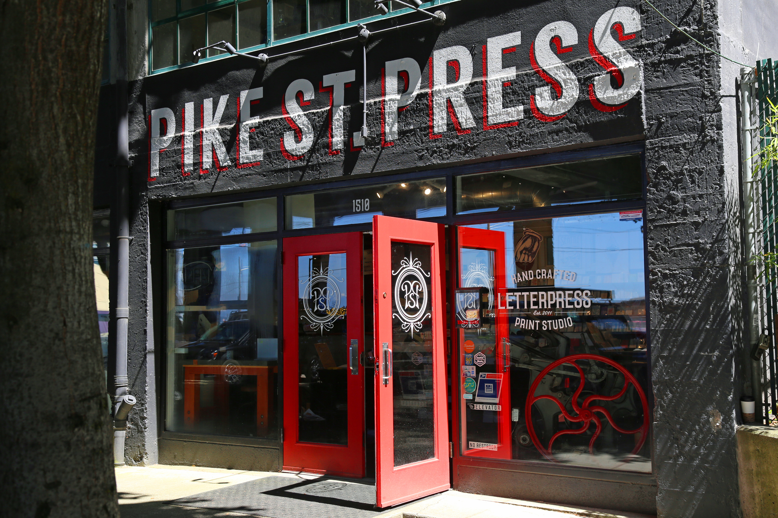 Pretty red doors at Pike Place Press.