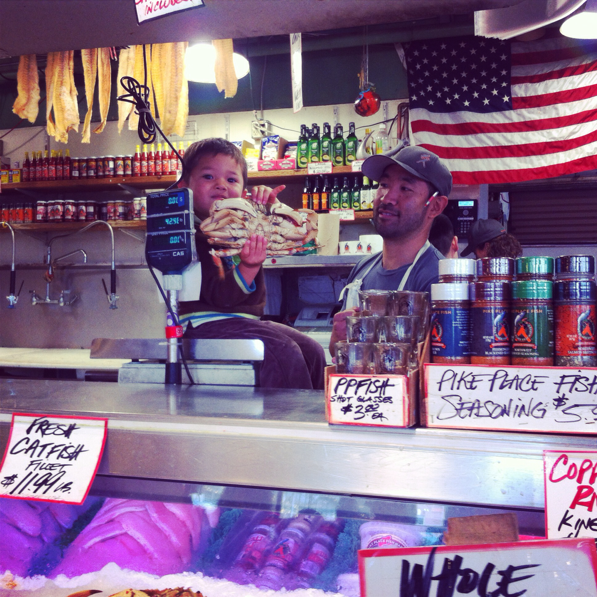 The guys at Pike Place Fish give kids the ultimate experience