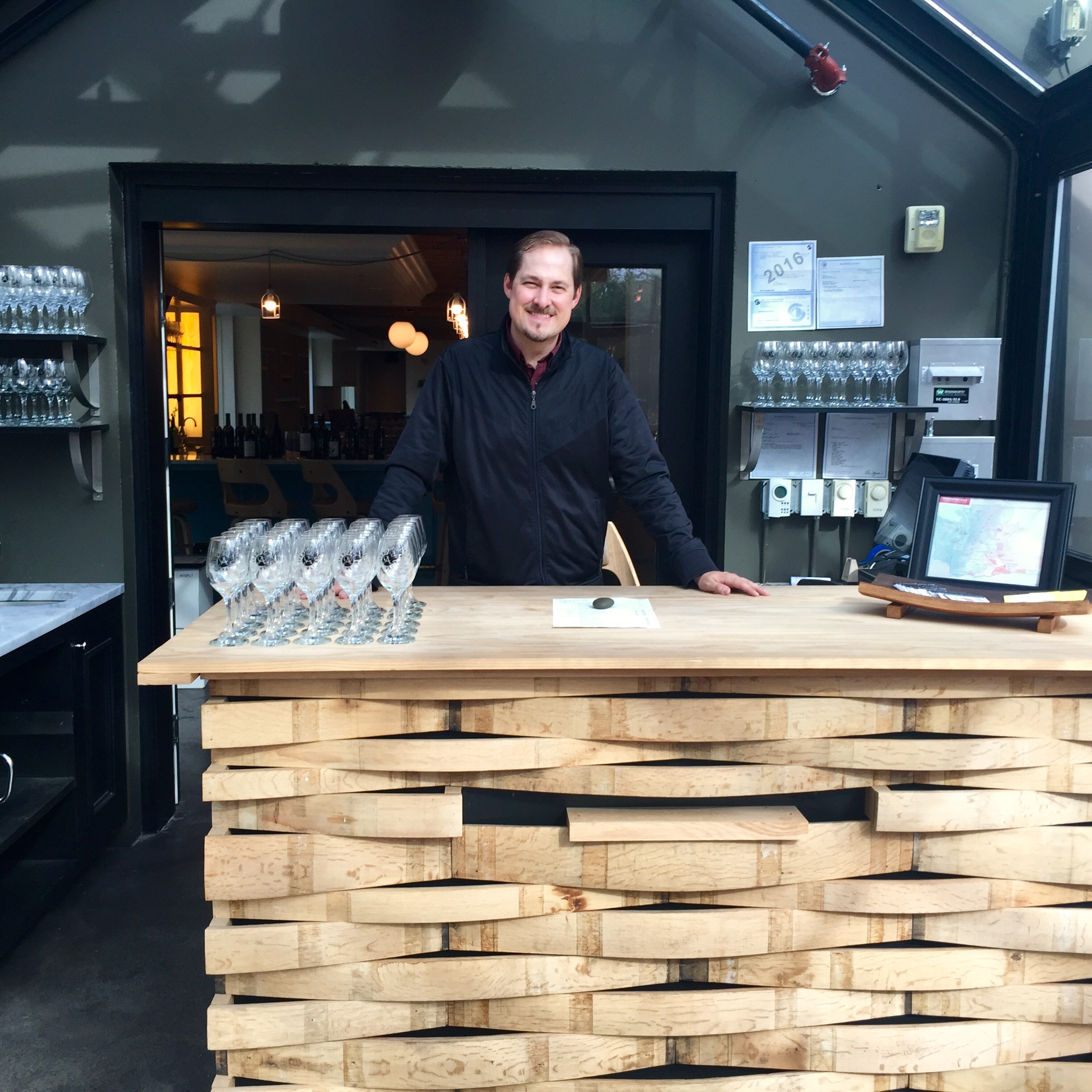 Ben Almquist showcasing the bar in the lovely greenhouse at 198 Nickerson St.