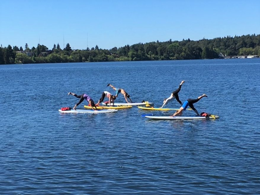 Yoga on the lake! Photo courtesy of SUP Yoga Seattle.