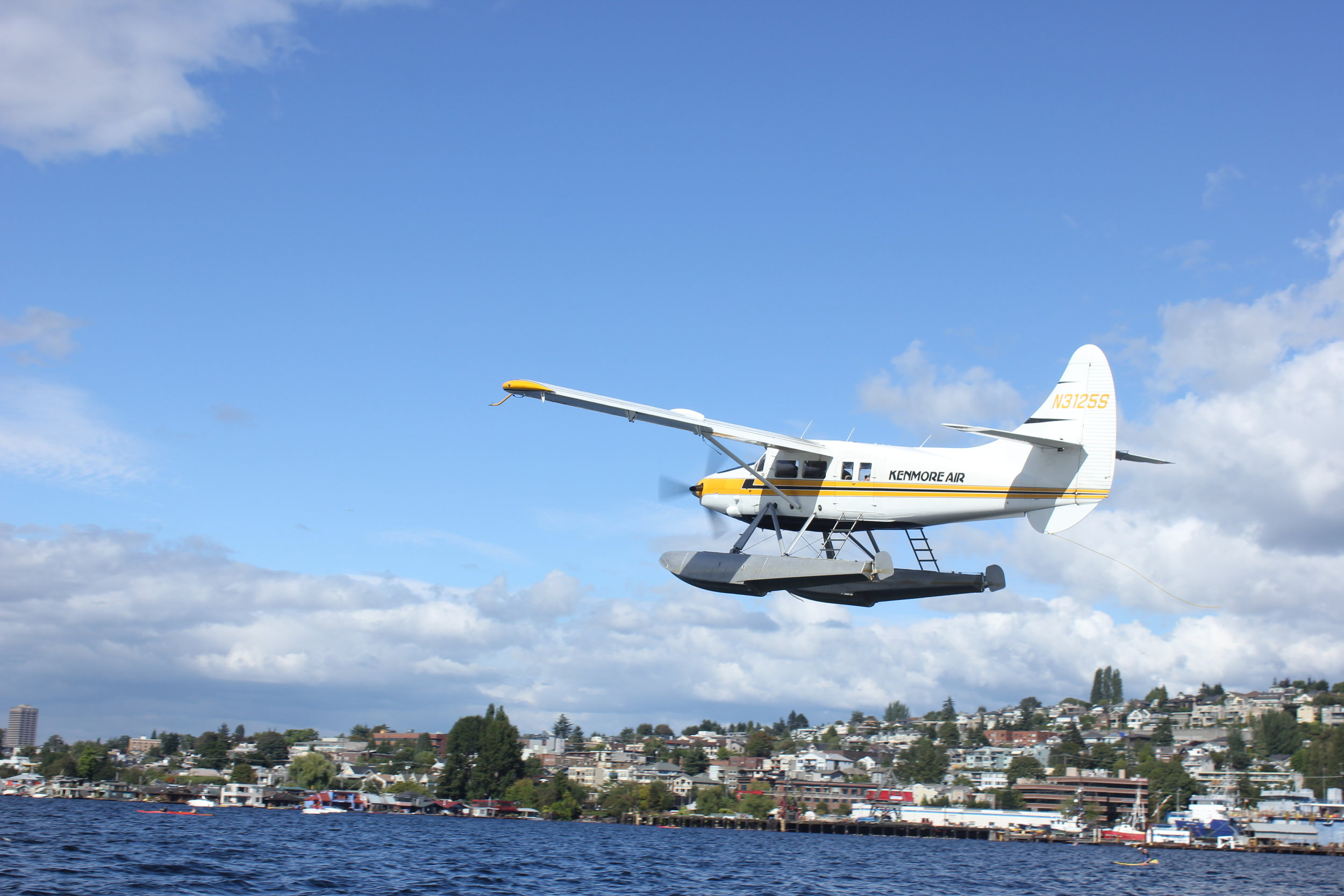Kenmore Air seaplane comes in for a landing on Lake Union.