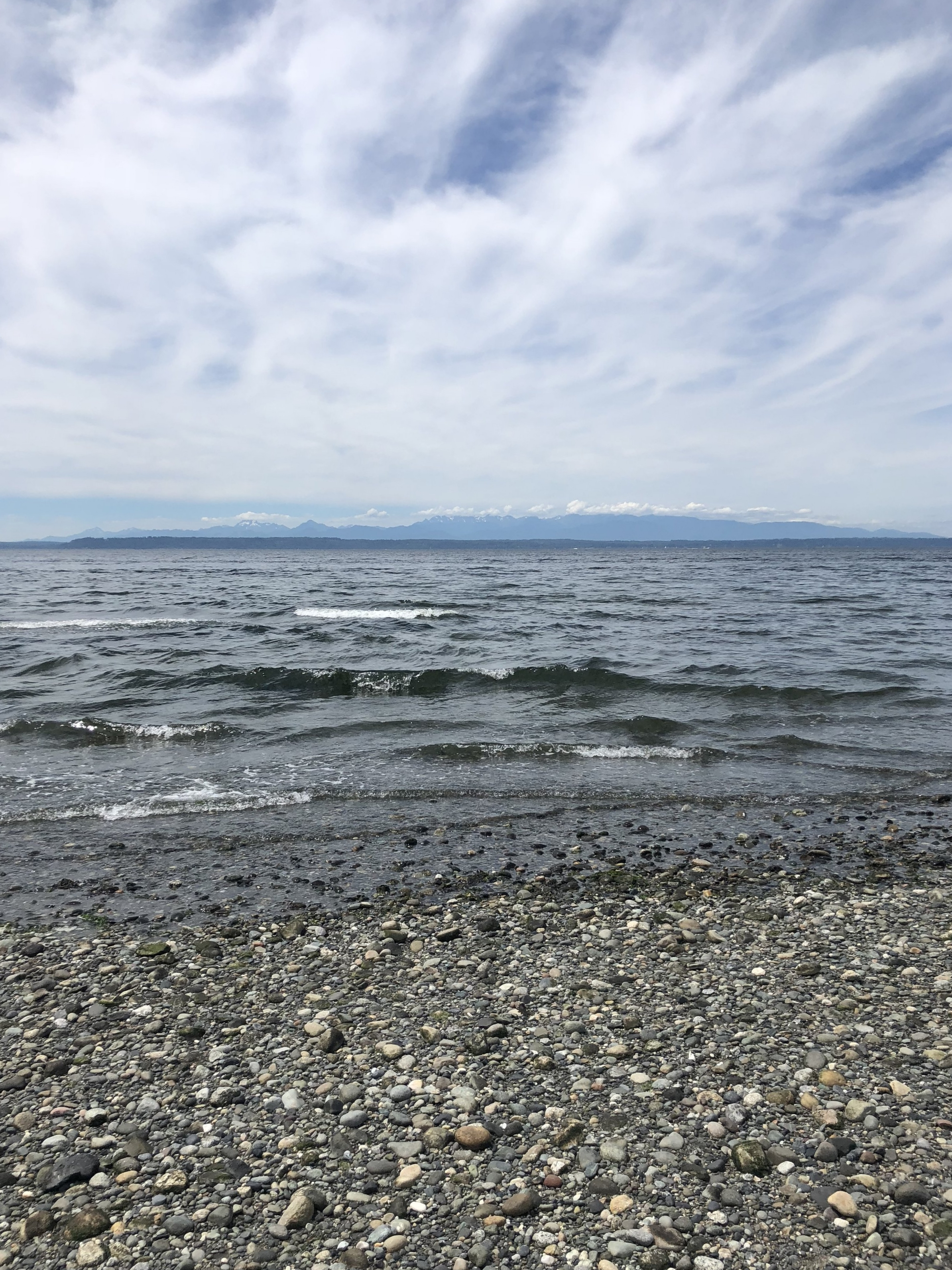 Enjoying the sounds of the ocean and taking in the views of the Olympic Mountains from the beach at the end of the hike.