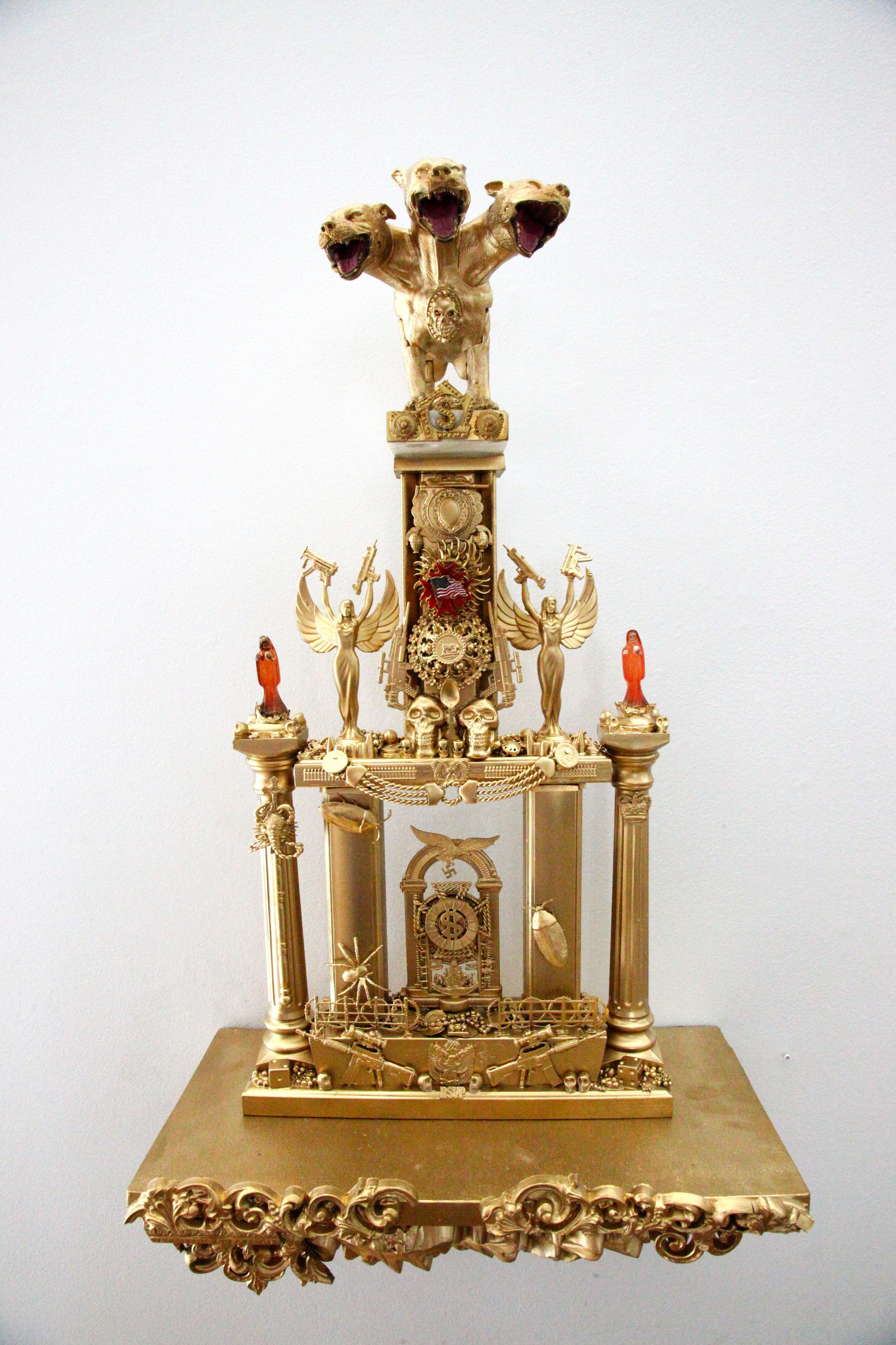 """Trophy #6 -- Cerebus, The Guardian of the Gates of Hell""  Mixed media, found objects  26"" x 12 1/2"" w/o shelf, 33"" x 17 1/2"" w/shelf  2016"