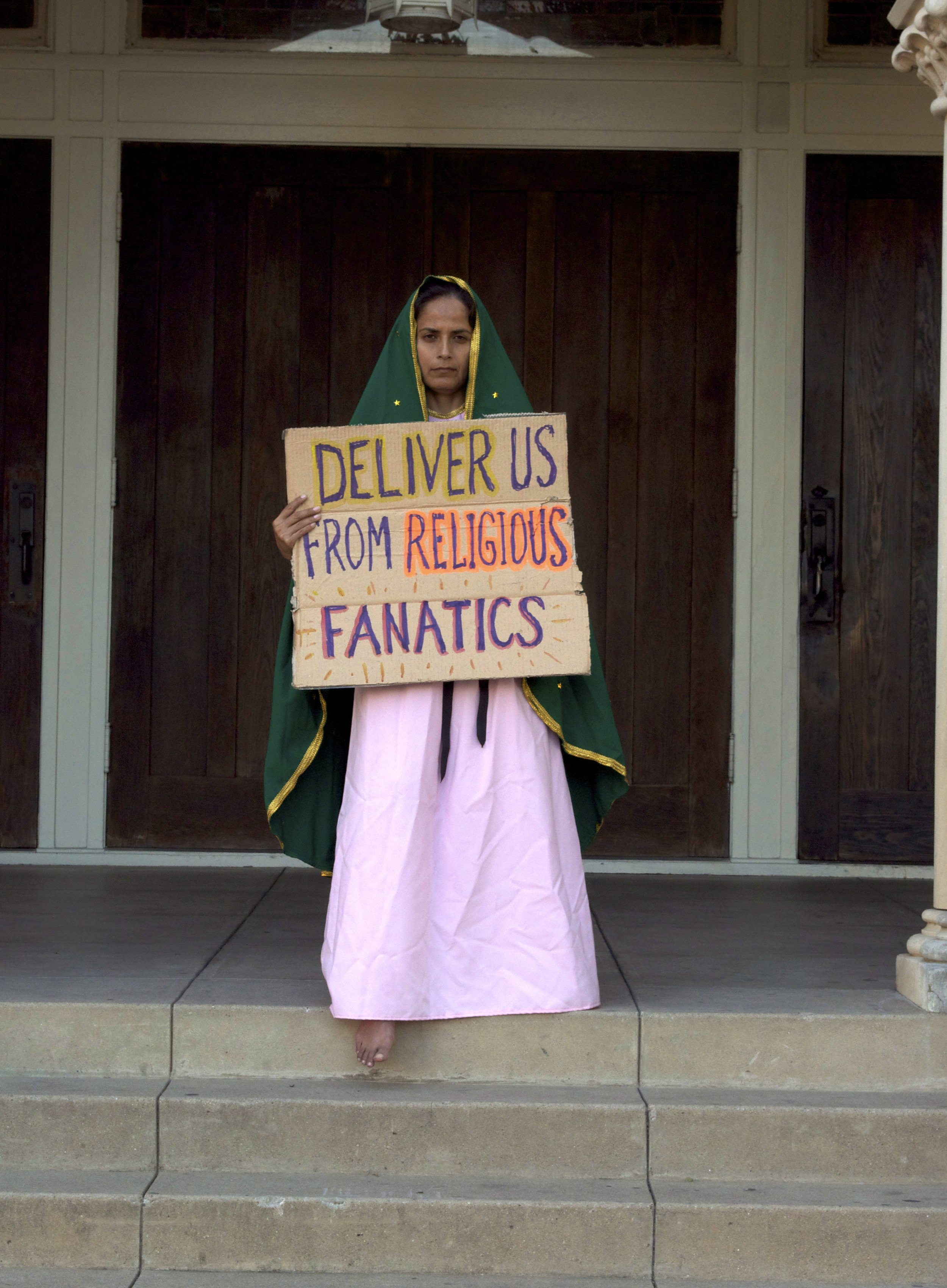 """""""Deliver Us From Religious Fanatics""""  Photograph of performance  2011"""