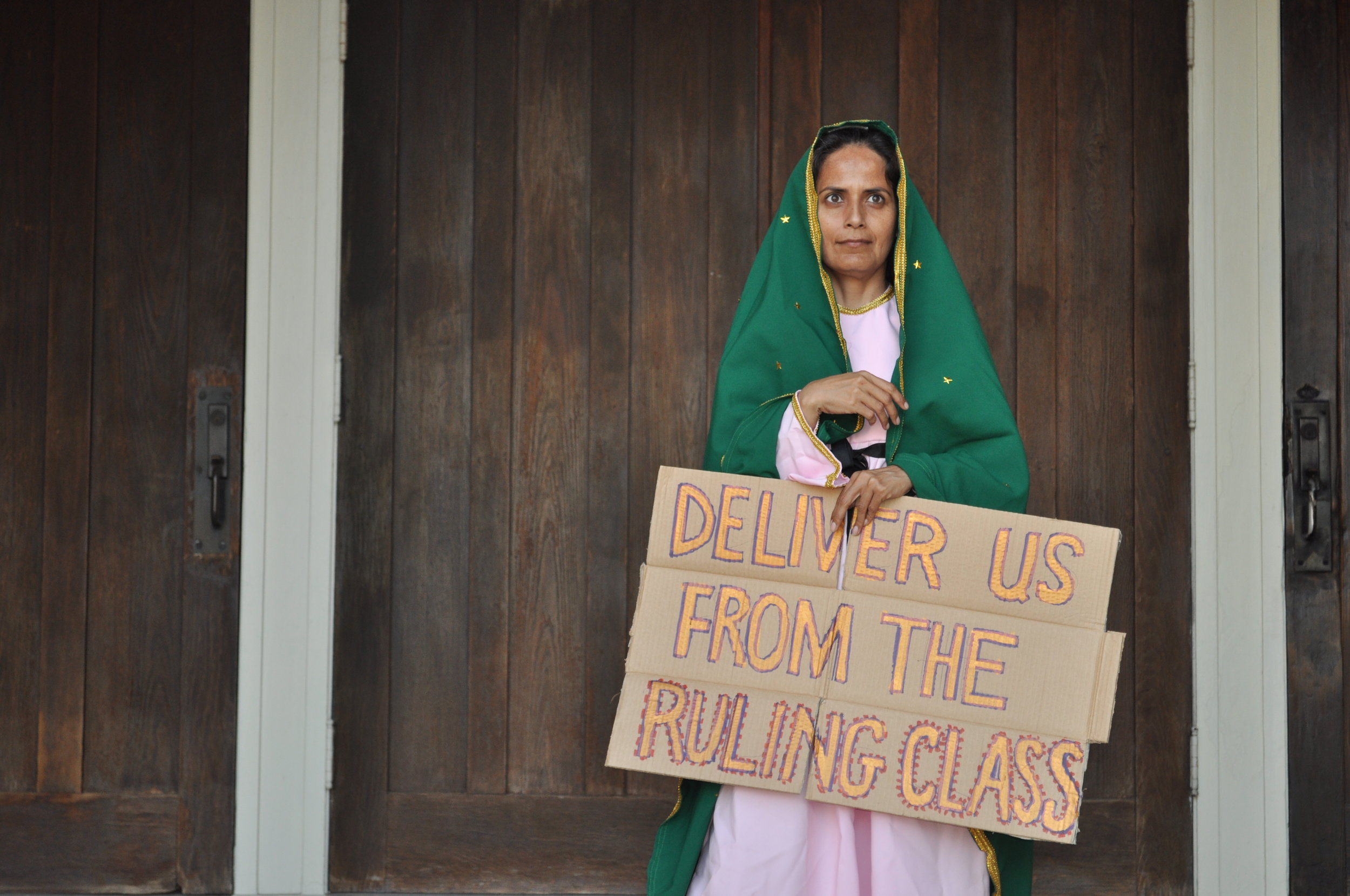 """""""Deliver Us From the Ruling Class""""  Photograph of performance  2011"""