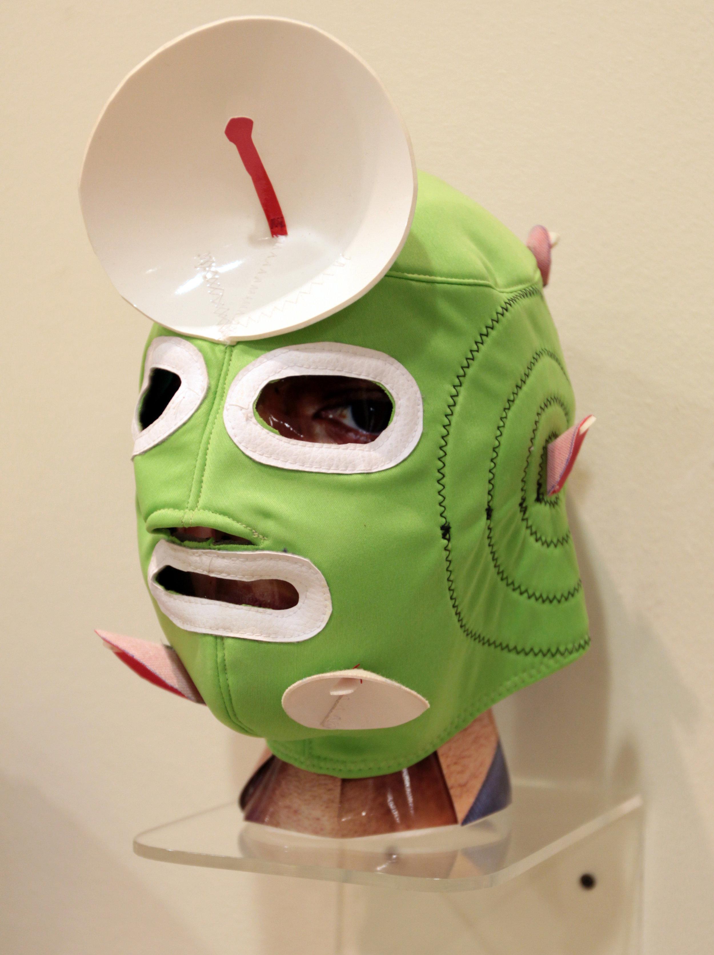 """Green Satellite Disk Mask""  Mixed media"