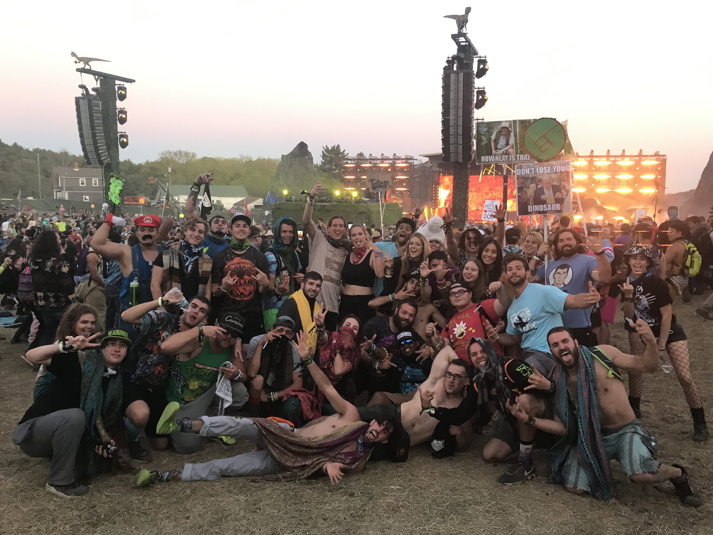 A group photo of most of our group in front of the Paradox stage.