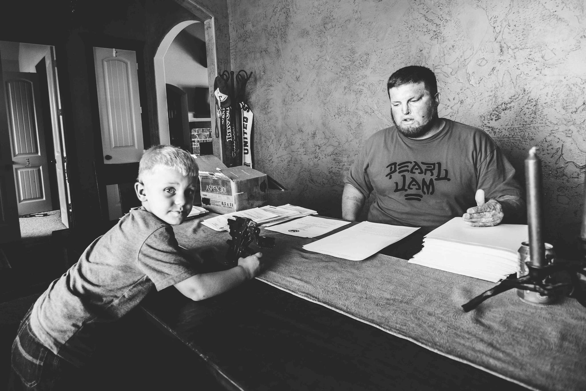 Joe with son King and a mountain of VA paperwork.