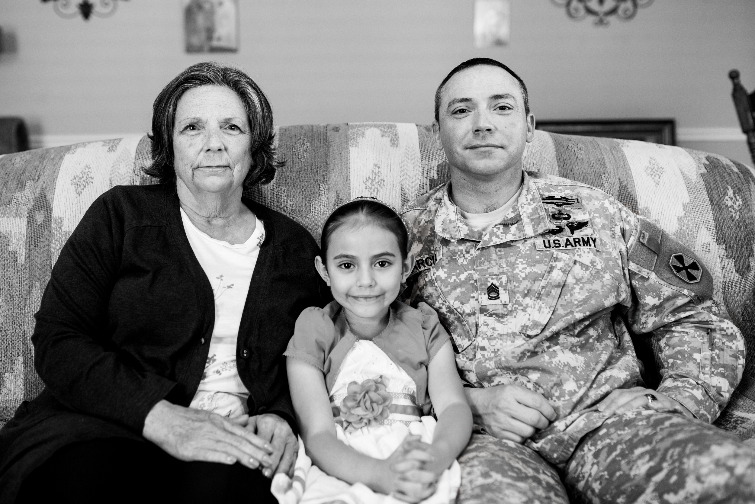 SFC Garcia seated with his mom Brenda (retired Air Force) and daughter Kaylee.