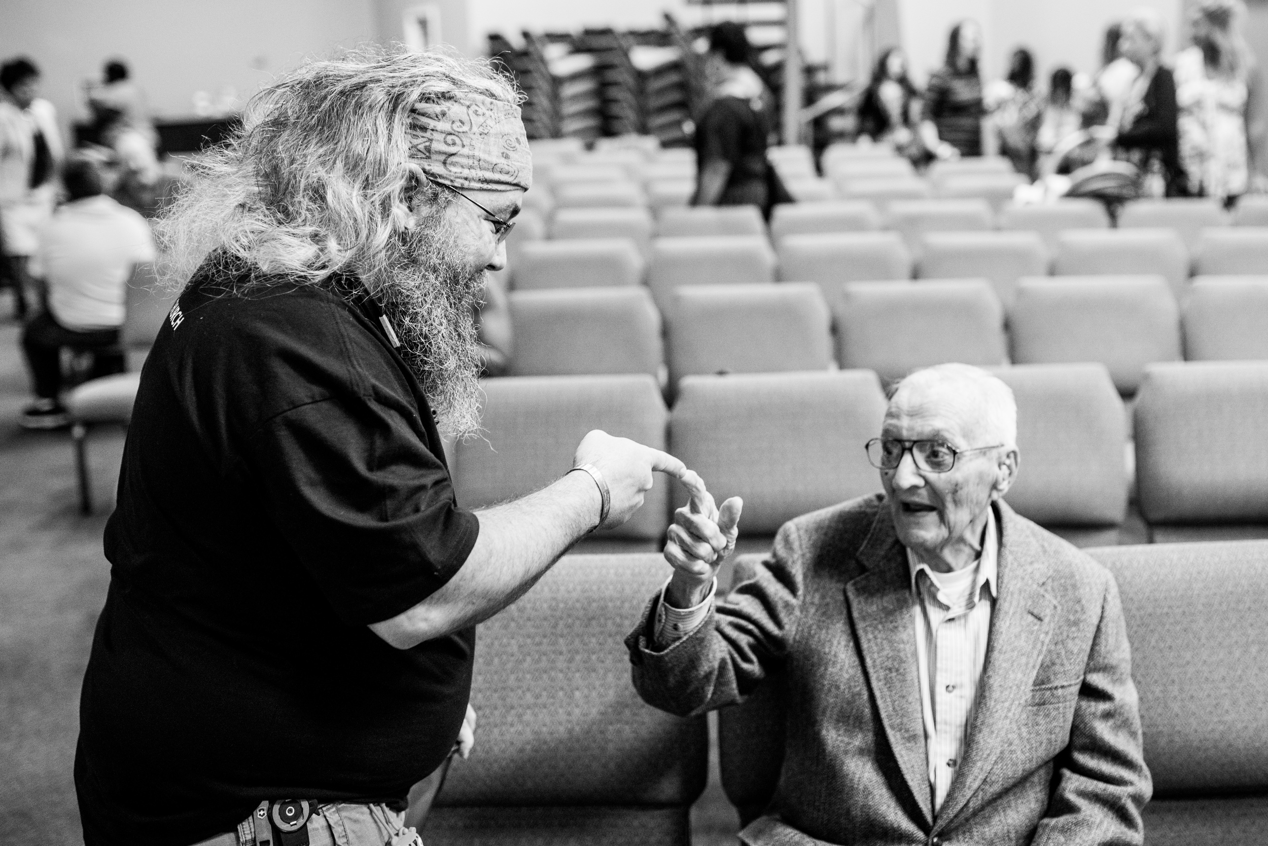 "Terry shares his ""secret handshake"" with one of Faith Point's regular attendees."