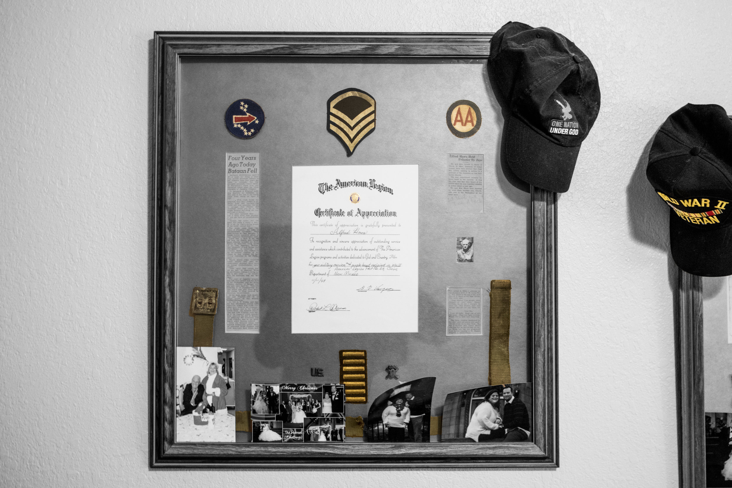 This shadow box contains an article on the Bataan Death March (left), above that the unit patch of the 200th Coastal Artillery, in the middle the Certificate of Appreciation from the American Legion, to the upper right below unit crest is the newspaper clipping informing others of his capture by the Japanese, and below that is a letter from Alfred to his parents from the Japanese camp.  The belt he used as a tourniquet to stop the bleeding from his right arm after an Allied Forces bomb hit the plant he was working in.