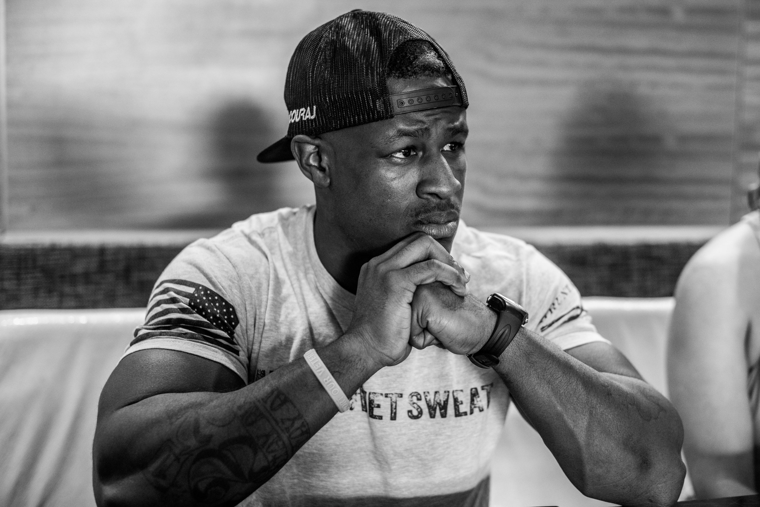 Justin sits in a meeting with an even coordinator for his annual MAVS Classic, which highlights veterans in the bodybuilding and physique industries.