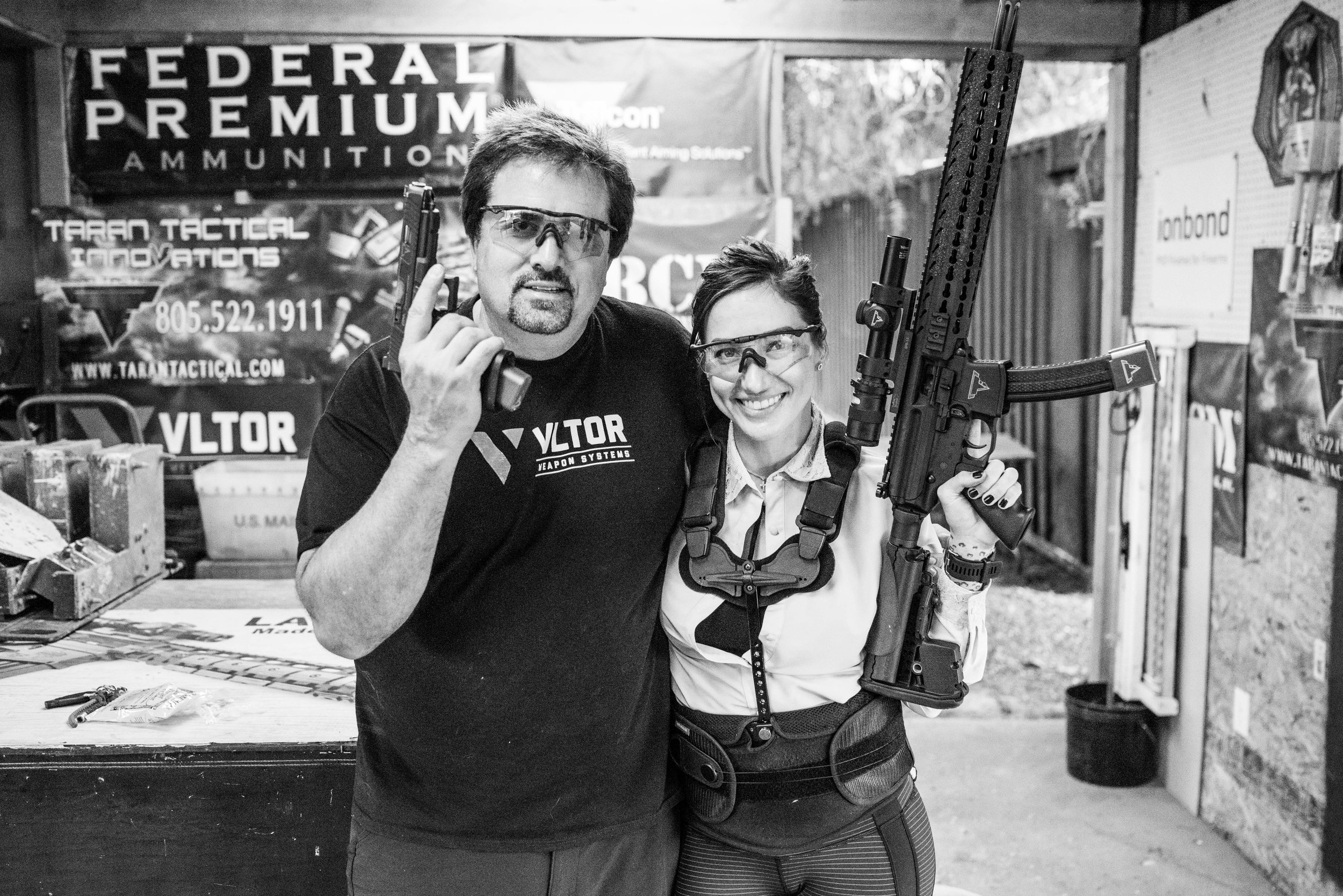 Jacqueline stands with her trainer, Taran Butler, of Taran Tactical.