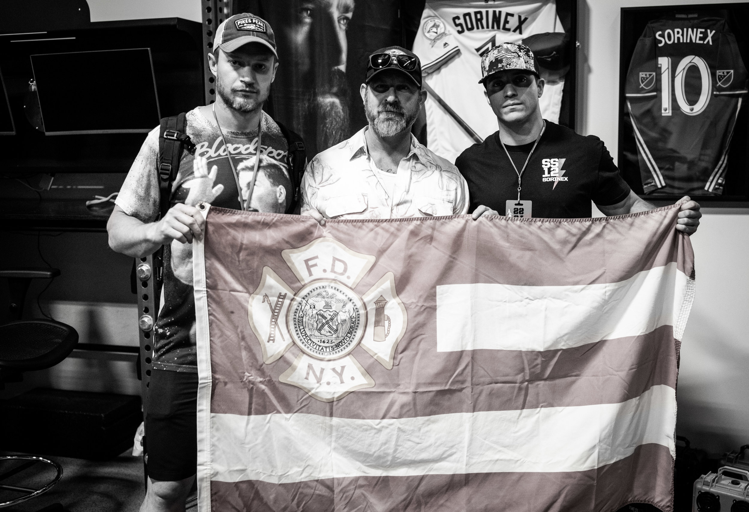 Brady stands with the FDNY Ladder 10 Flag owned by his friend, Duncan Butler. Duncan is the Business Development Specialist for Zac Brown Band.