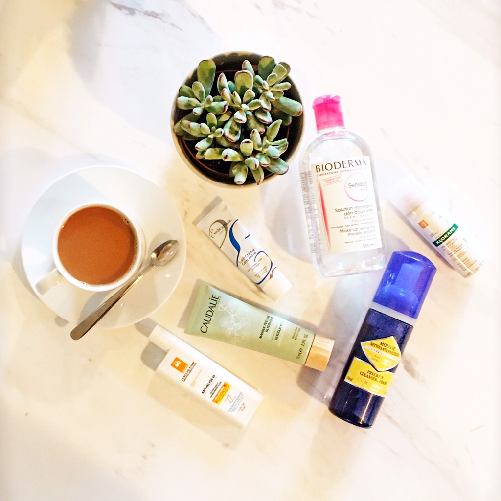 clockwise from top: Bioderma, Klorane dry shampoo, L'Occitane cleanser, La Roche-Posay sunscreen, Caudalie Glycolic Peel, and Embryolisse cream.