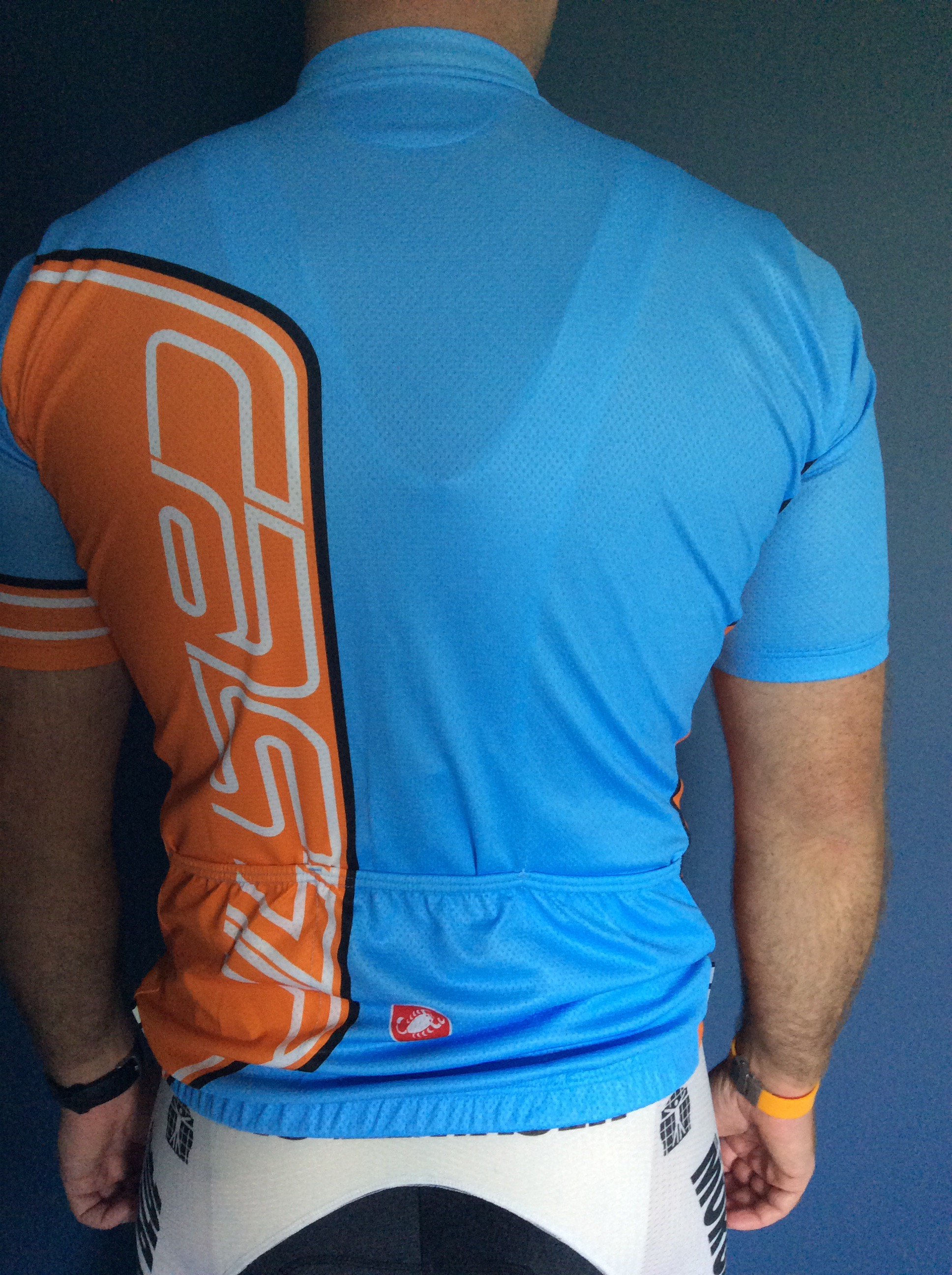 Fresh out of the bag with the blue, orange, white, and black colors of the old Gulf Ford GT40 from the 1960s . This is the same size I order for other Castelli garments, only this one is extremely loose around the pocket area. Castelli stated this jersey should be tight-fitting without any flapping. I returned it for the next size down.